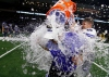 Dec 23, 2016 -- Frisco, TX, U.S.A -- GEICO State Champions Bowl Series. -- Chandler Wolves head coach Shaun Aguano gets the water bath from Parker Henley (40) following the 44-24 victory over the Valdosta Wildcats. Photo by Ray Carlin-USA TODAY Sports Images, Gannett ORG XMIT: US 135851 GEICO preps 12/23/201 [Via MerlinFTP Drop]