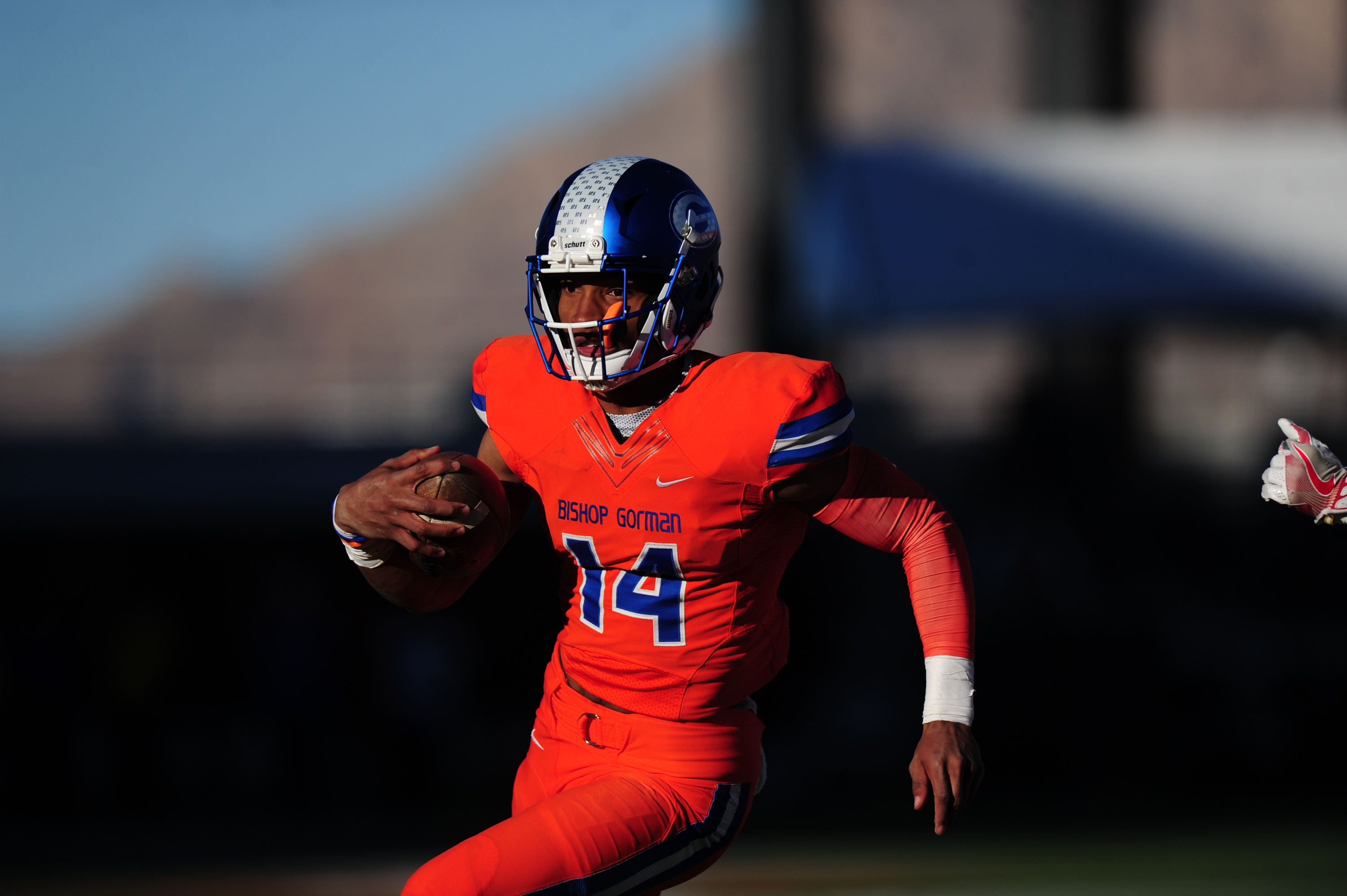 LAS VEGAS, NV - DECEMBER 03: Bishop Gorman quarterback Dorian Thompson-Robinson rushes for a touchdown against the Liberty Patriots in the second half of the NIAA class 4A championship game on December 03, 2016, at Sam Boyd Stadium in Las Vegas, NV. Gorman defeated Liberty 84-8. (Icon Sportswire via AP Images) ORG XMIT: 274672 [Via MerlinFTP Drop]