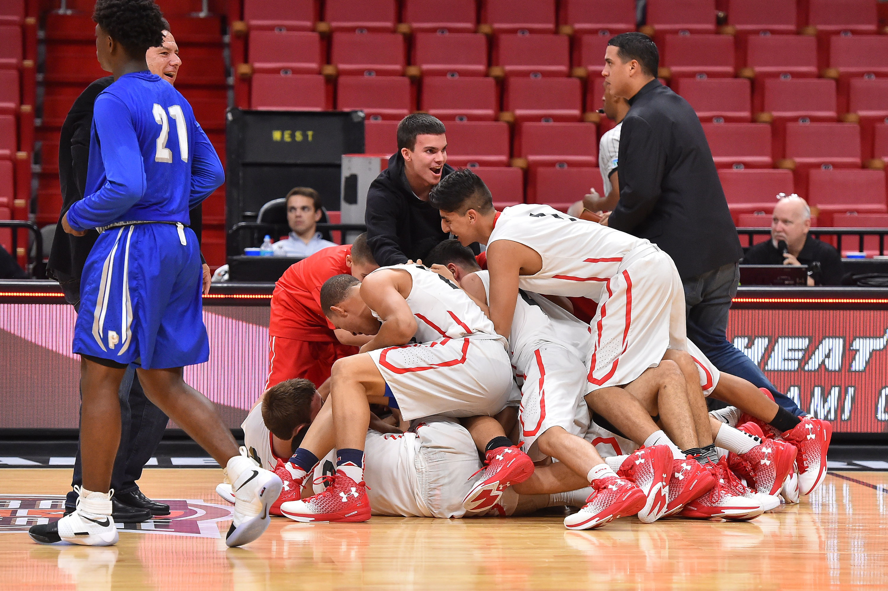 12/8/16 8:30:46 PM -- Miami, FL, U.S.A -- Miami Christian teammates celebrate after defeating Dillard 69-67 during the second half of the HoopHall Miami Invitational. -- Photo by Jasen Vinlove-USA TODAY Sports Images, Gannett ORG XMIT: US 135835 hoophall 12/8/2016 [Via MerlinFTP Drop]