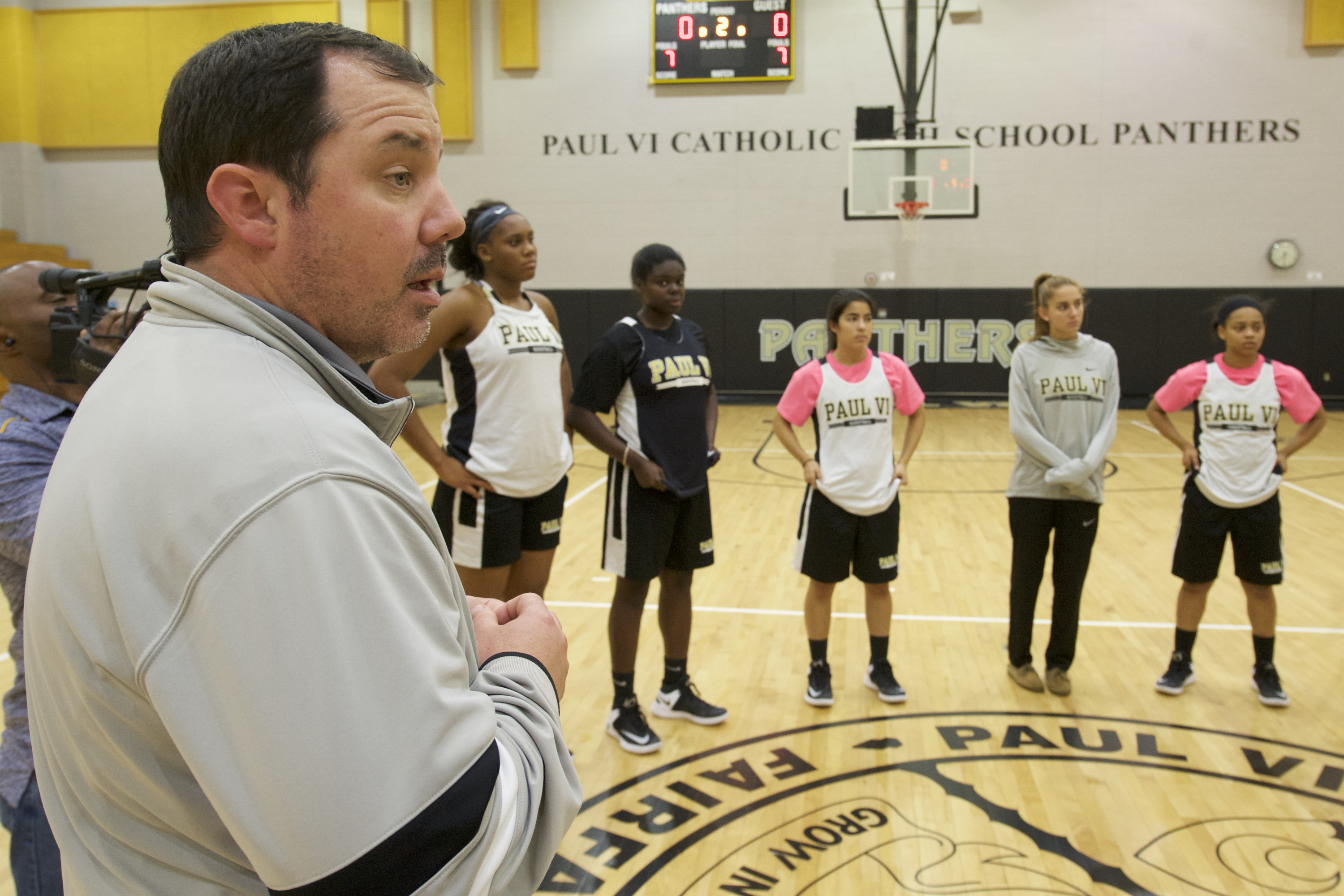 11/14/16 7:29:41 PM -- Fairfax, VA, U.S.A -- Paul VI Catholic High School in Fairfax, Virginia will be one of our top ranked girls basketball teams. Paul VI girl's basketball head coach talks to members of the team after practice. -- Photo by Rafael Suanes/USA TODAY Sports Images, Gannett ORG XMIT: US 135760 Pual VI 11/14/2016 [Via MerlinFTP Drop]