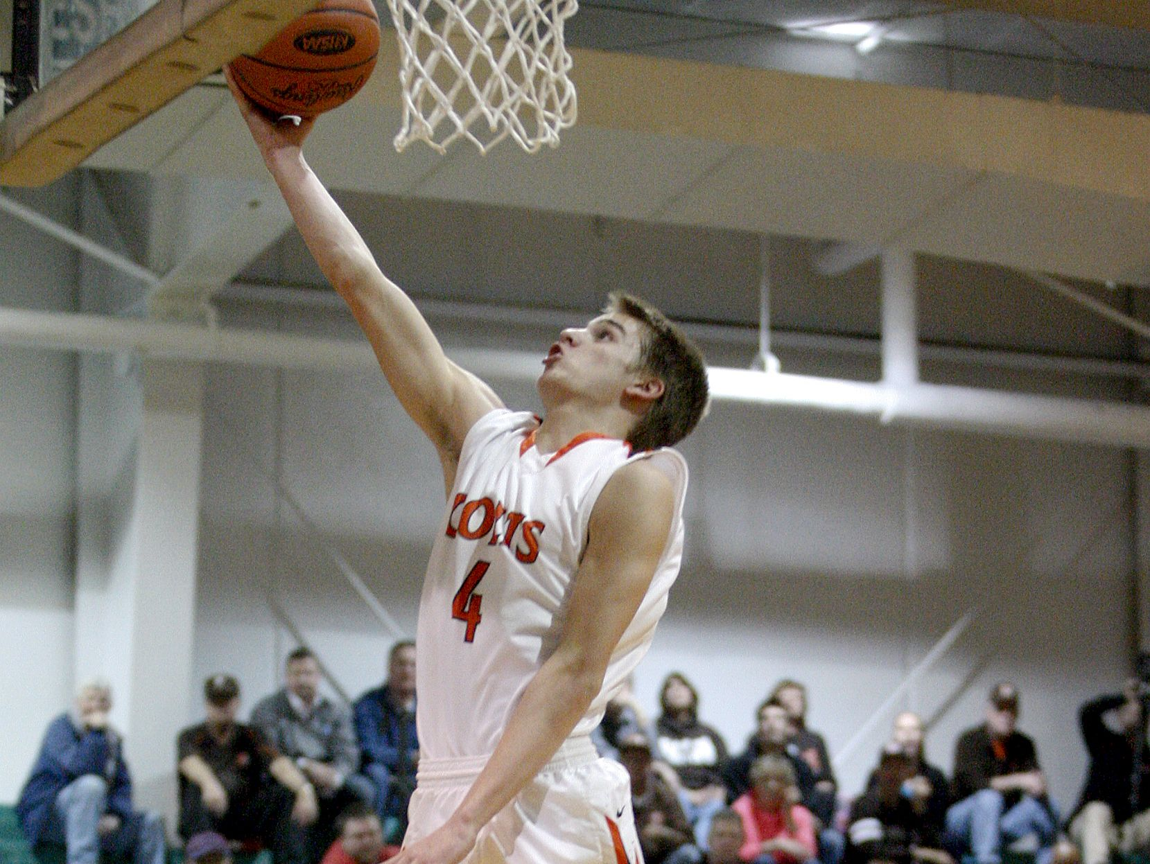 DeSales' Jaxon Burgess, #4, beats the defense for a layup against Western during their game at Western High School. Feb. 24, 2015