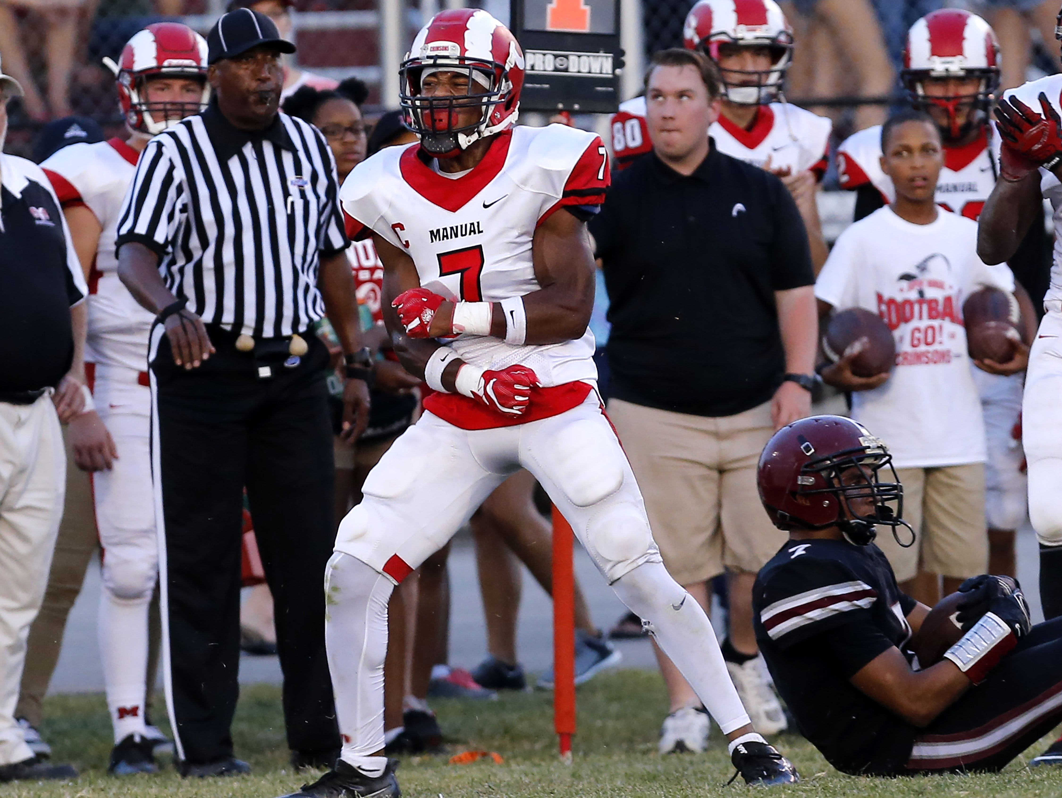 Manual's Bryce Cosby celebrates after tackling Ballard's Collin Brown. Sept. 16, 2016