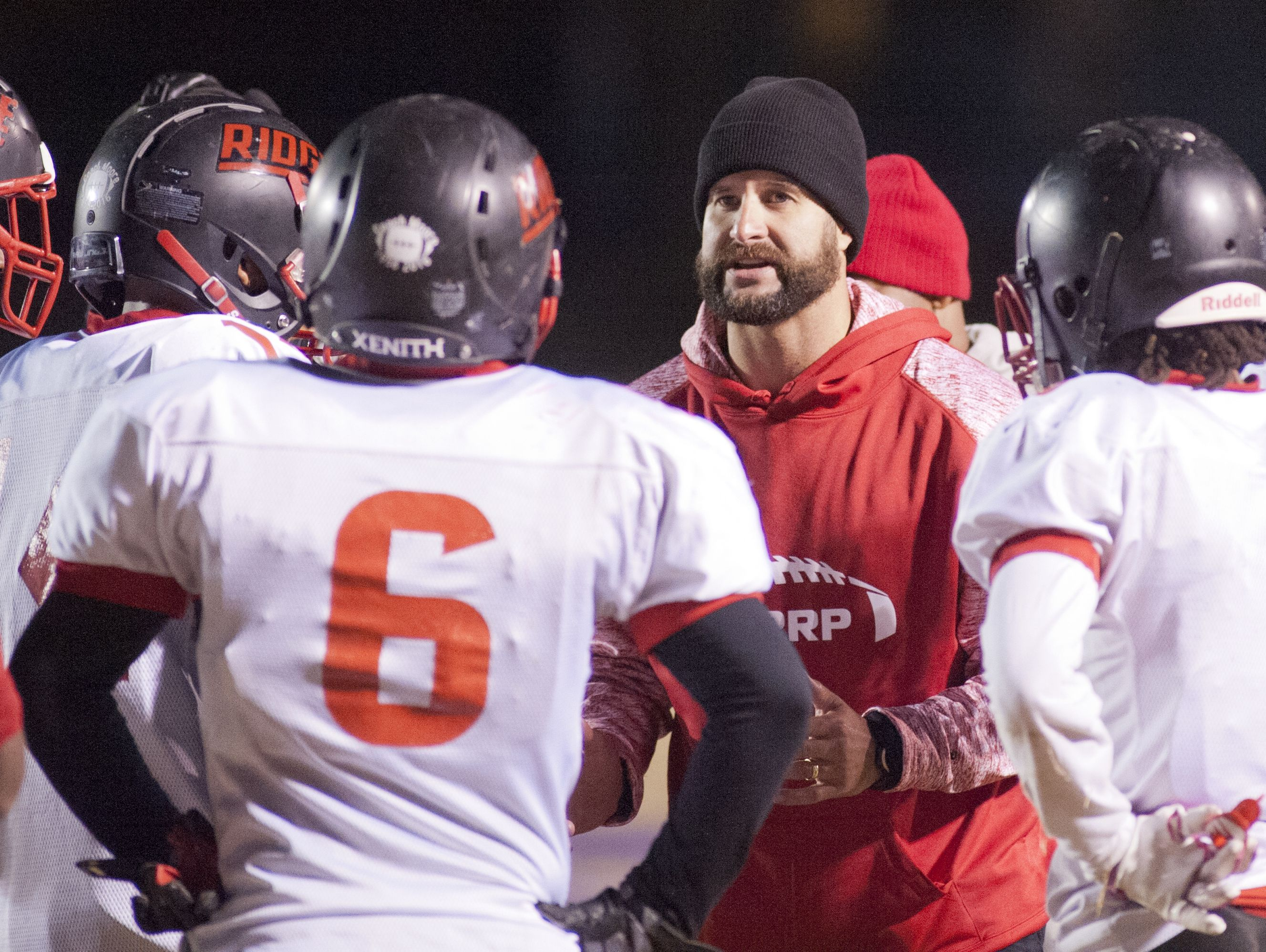 PRP head football coach Jason T. Hiser talks to his players during a time-out. 11 November 2016