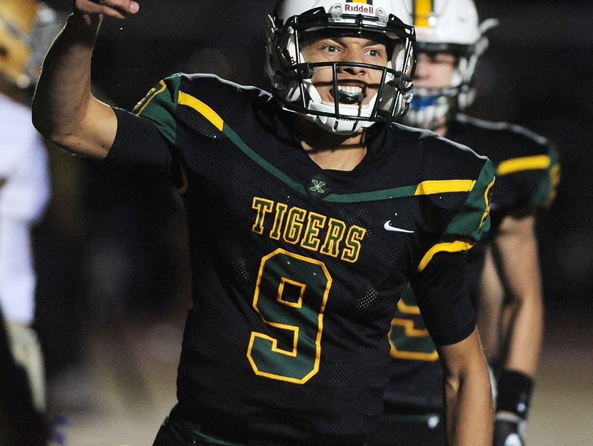 St. Xavier's Desmond Ridder (9) celebrates after scoring a touchdown against Male on Friday at St. Xavier High School. Nov. 18, 2016