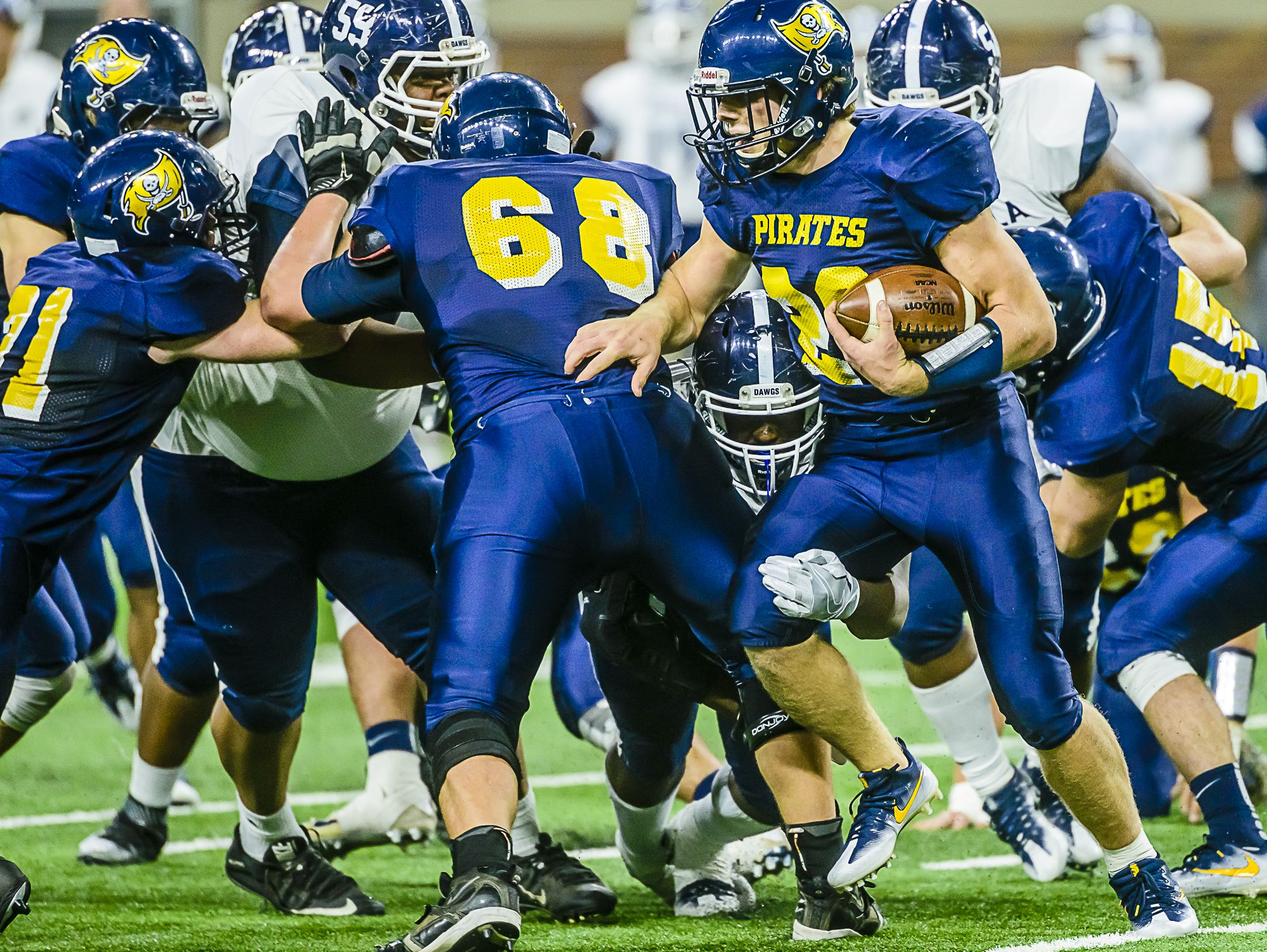 A Detroit Loyola defender gets a hand on the leg of Pewamo-Westphalia's Jared Smith while he's still in the backfield. The AP Division 7-8 Player of the Year was held in check by Loyola in the game.