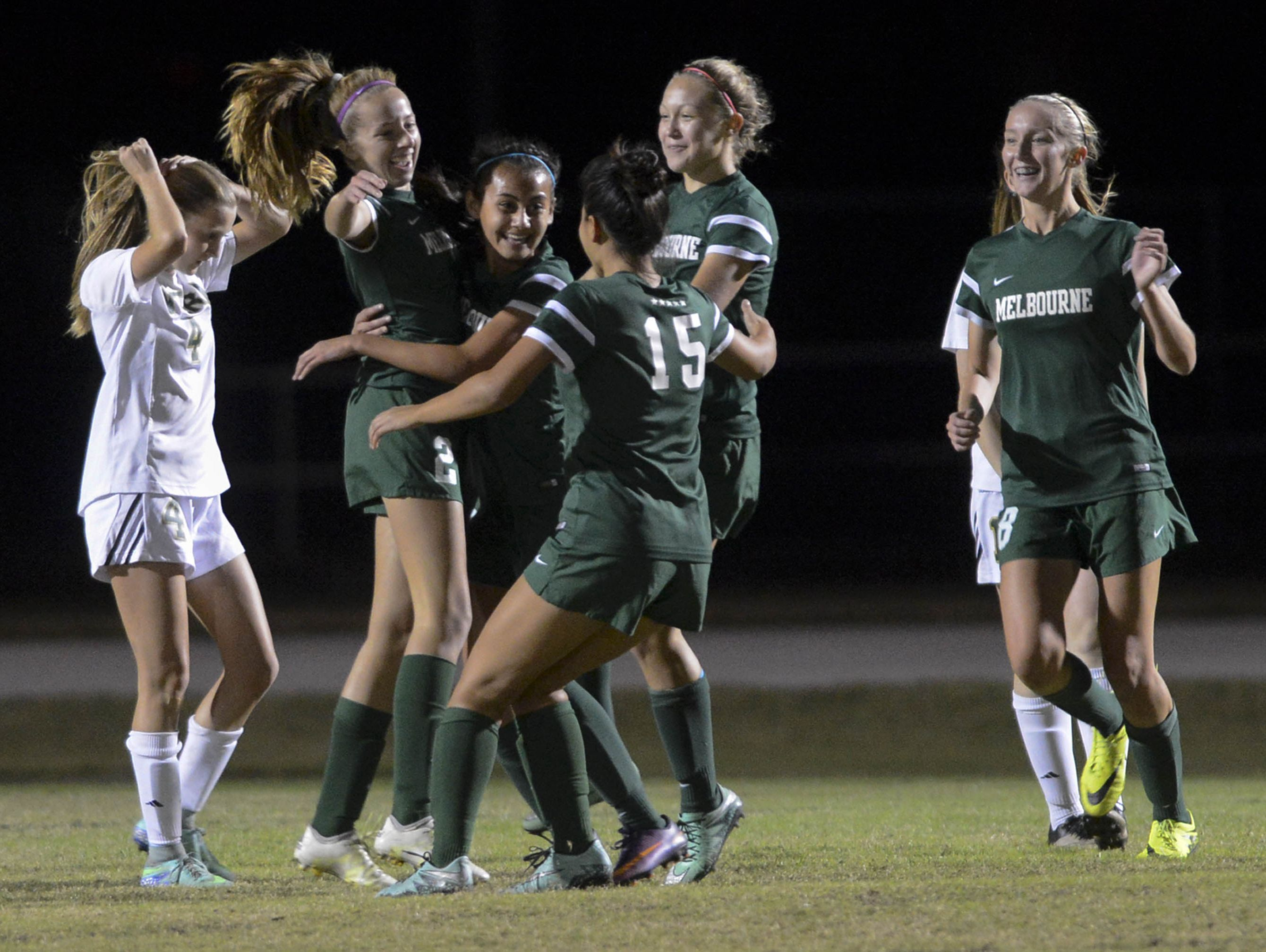 Melbourne players celebrate a first half goal during their game against Viera Friday evening.