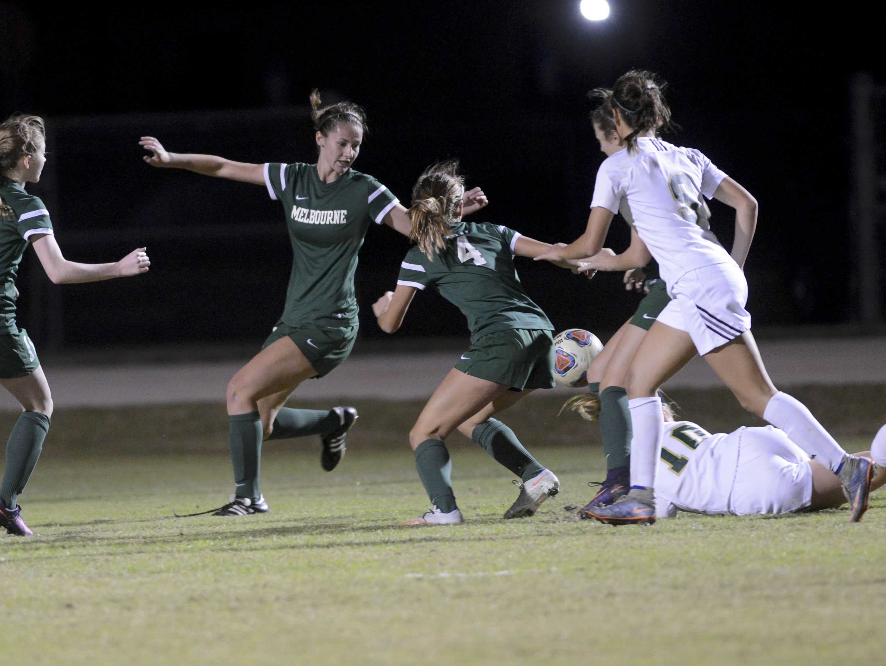 Melbourne and Viera players battle for control of the ball during their December game.