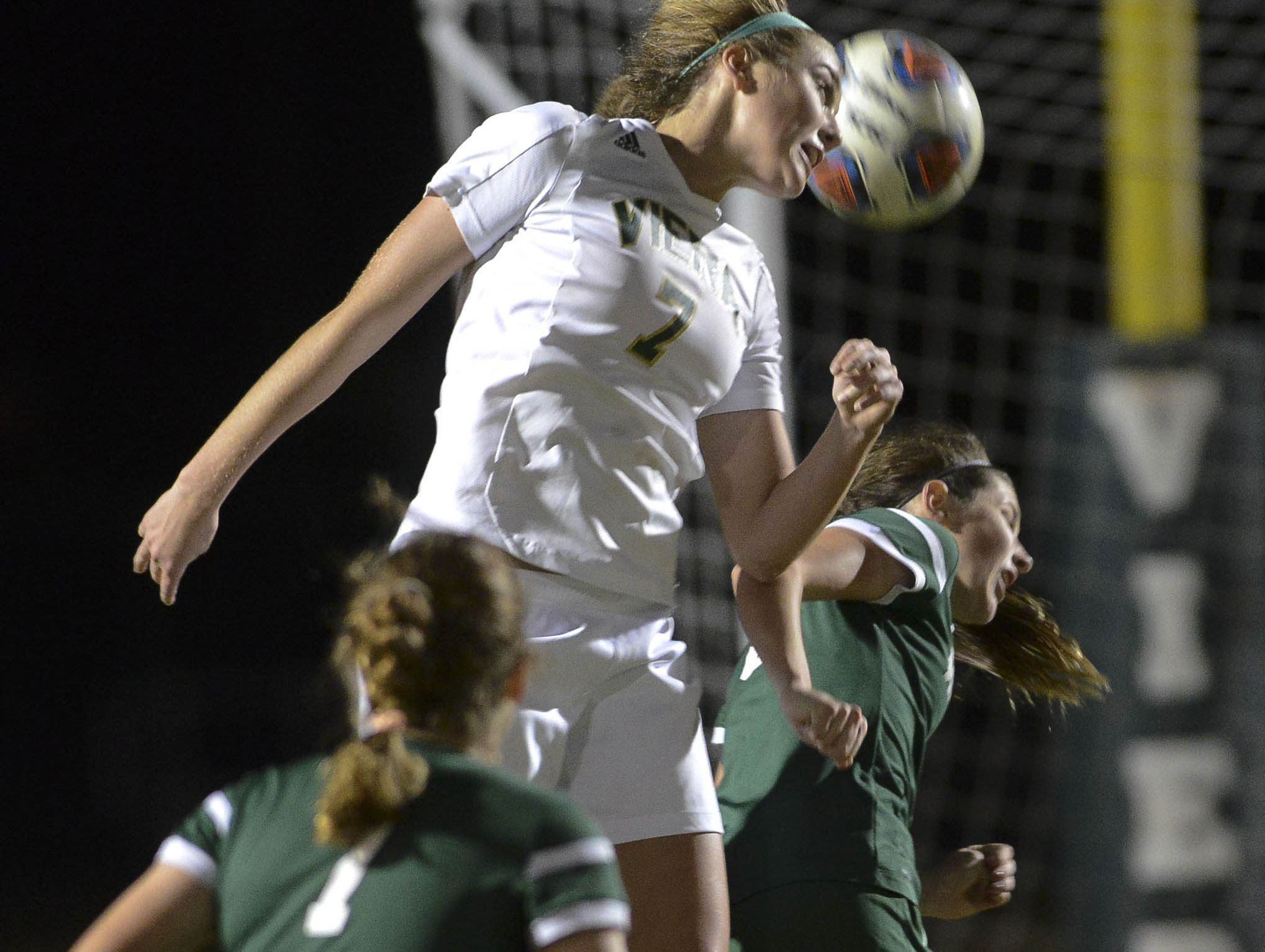 Viera's Hollyn Knight heads the ball away from Destiny Deluca of Melbourne during their game Friday evening.