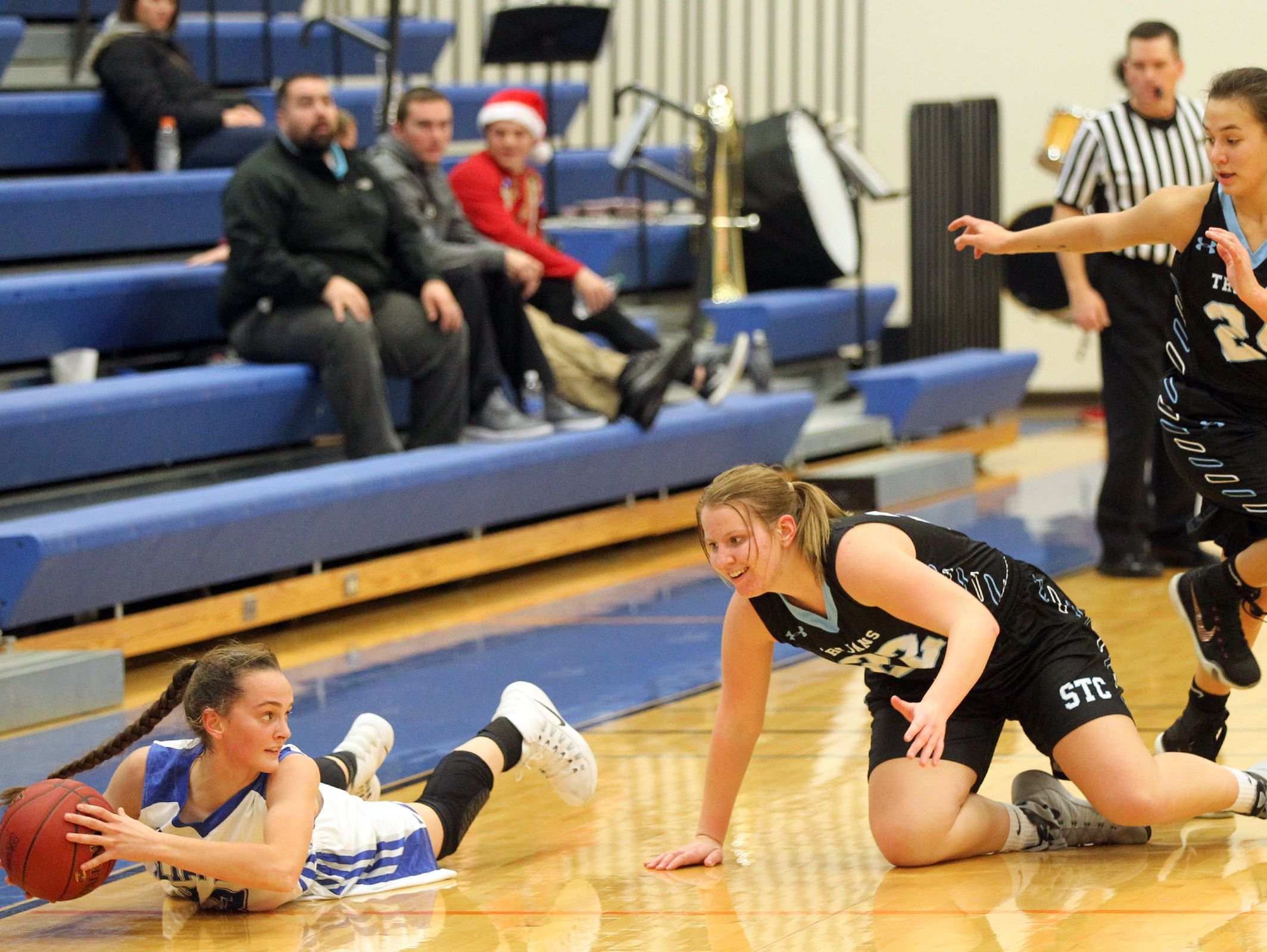 Clear Creek Amana's Karsyn Stratton dives for the ball during the Clippers' game against South Tama in Tiffin on Monday, Dec. 19, 2016.