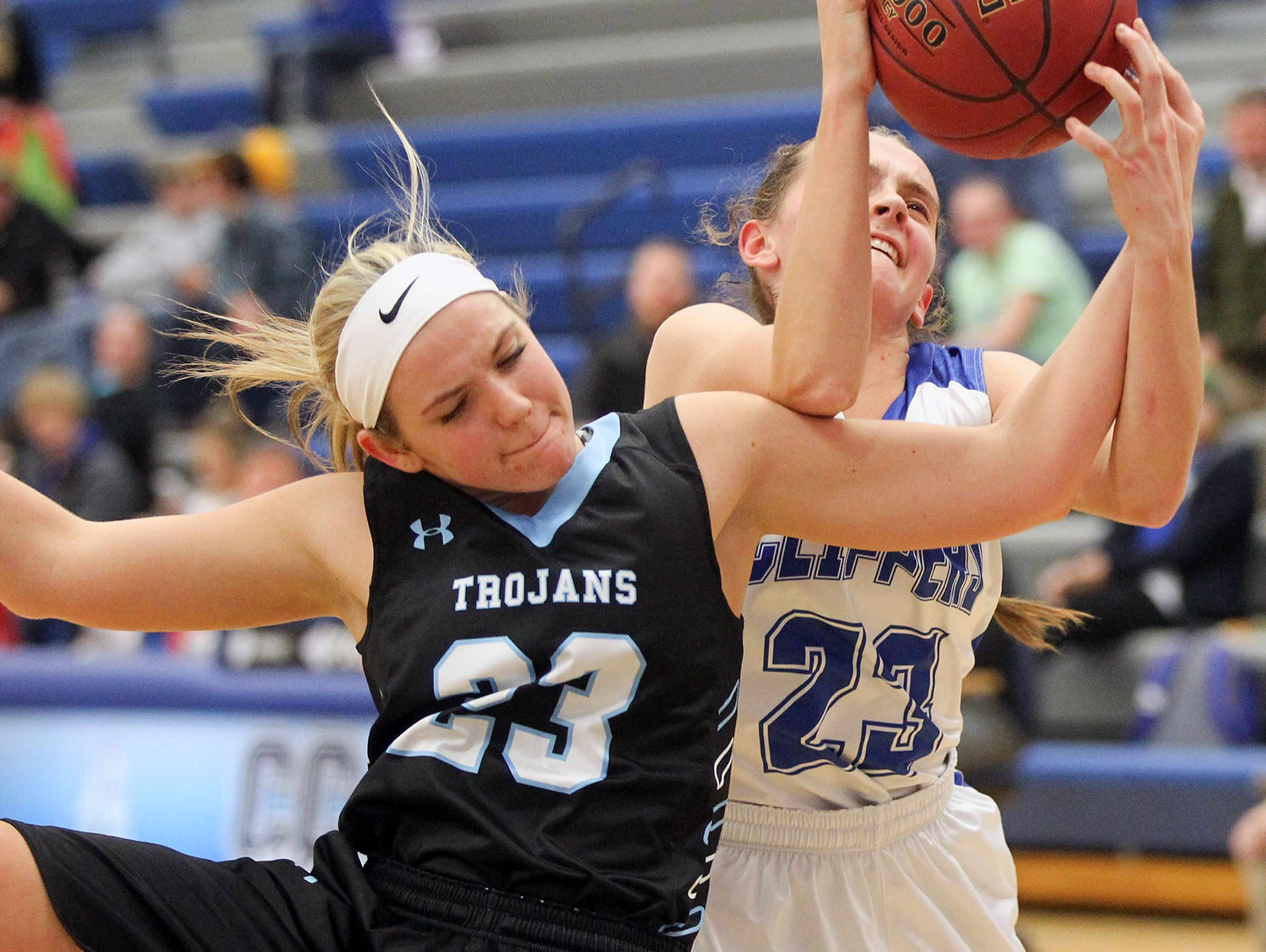 Cear Creek Amana's Karsyn Stratton and South Tama's Madison Rohach fight for a rebound during their game in Tiffin on Monday, Dec. 19, 2016.