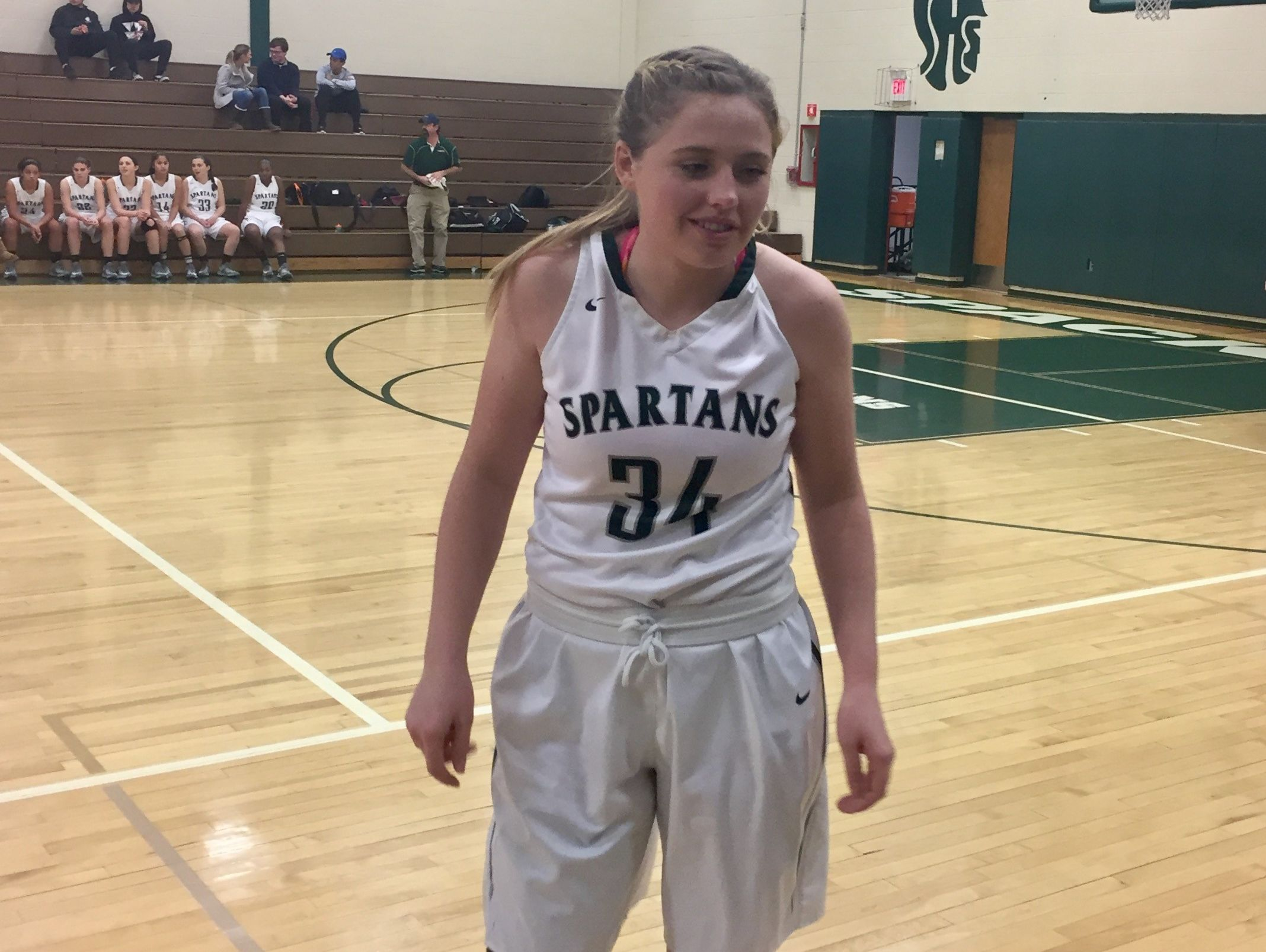Spackenkill's Eileen Fiore back on the basketball court sporting a knee brace in a December game against Ellenville.