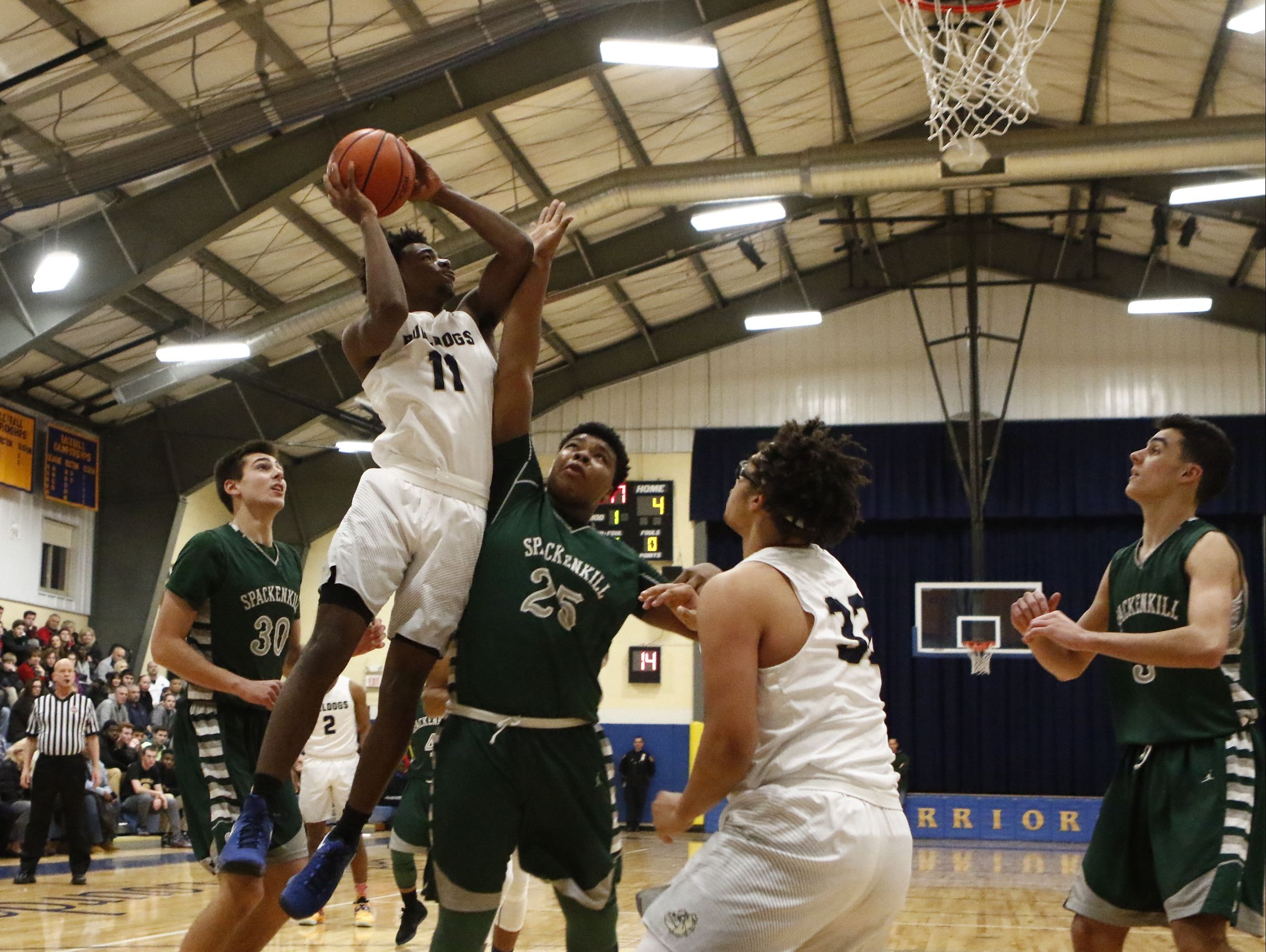 Beacon's Zamere McKenzie goes up for a shot against Spackenkill in the final of the Duane Davis Memorial Tournament on December 31, 2016.