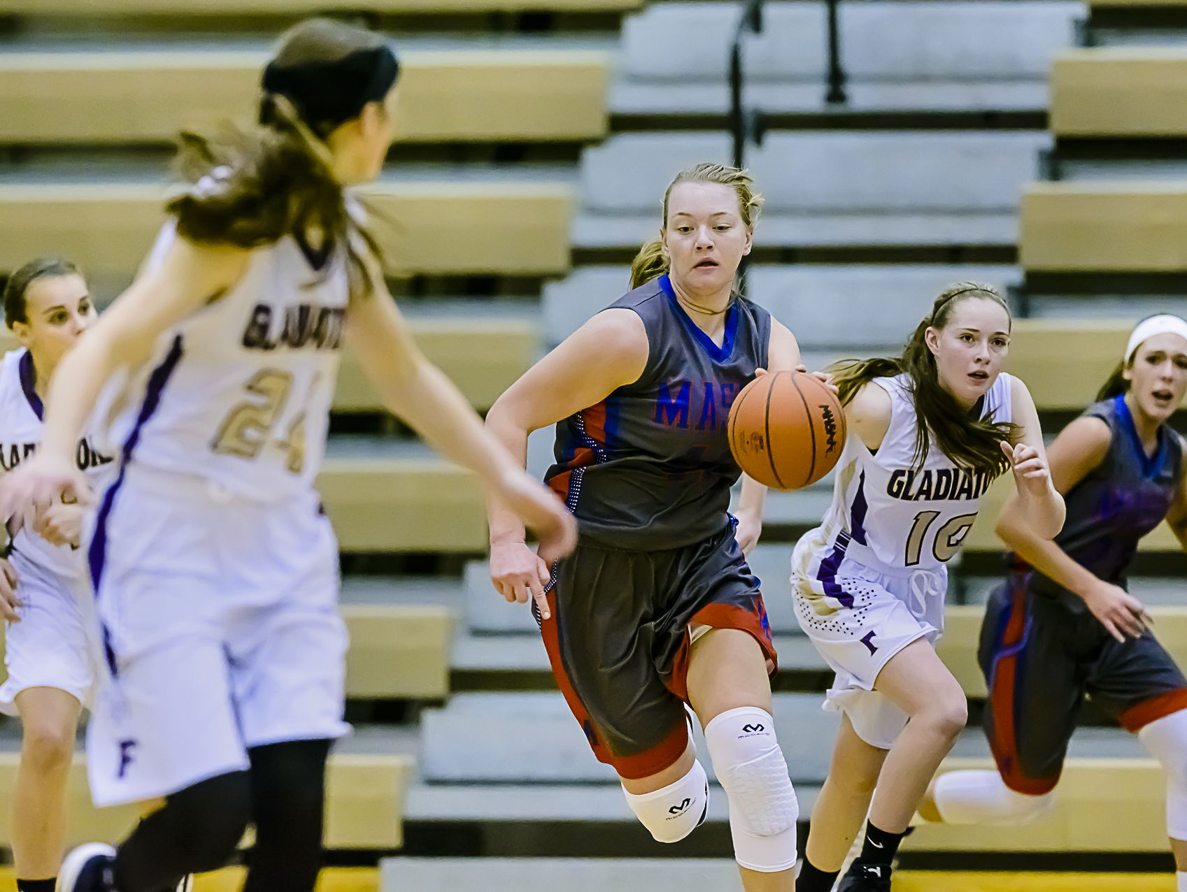 Autumn Kissman ,center, of Mason drives to the Fowlerville basket during their game in Fowlerville.