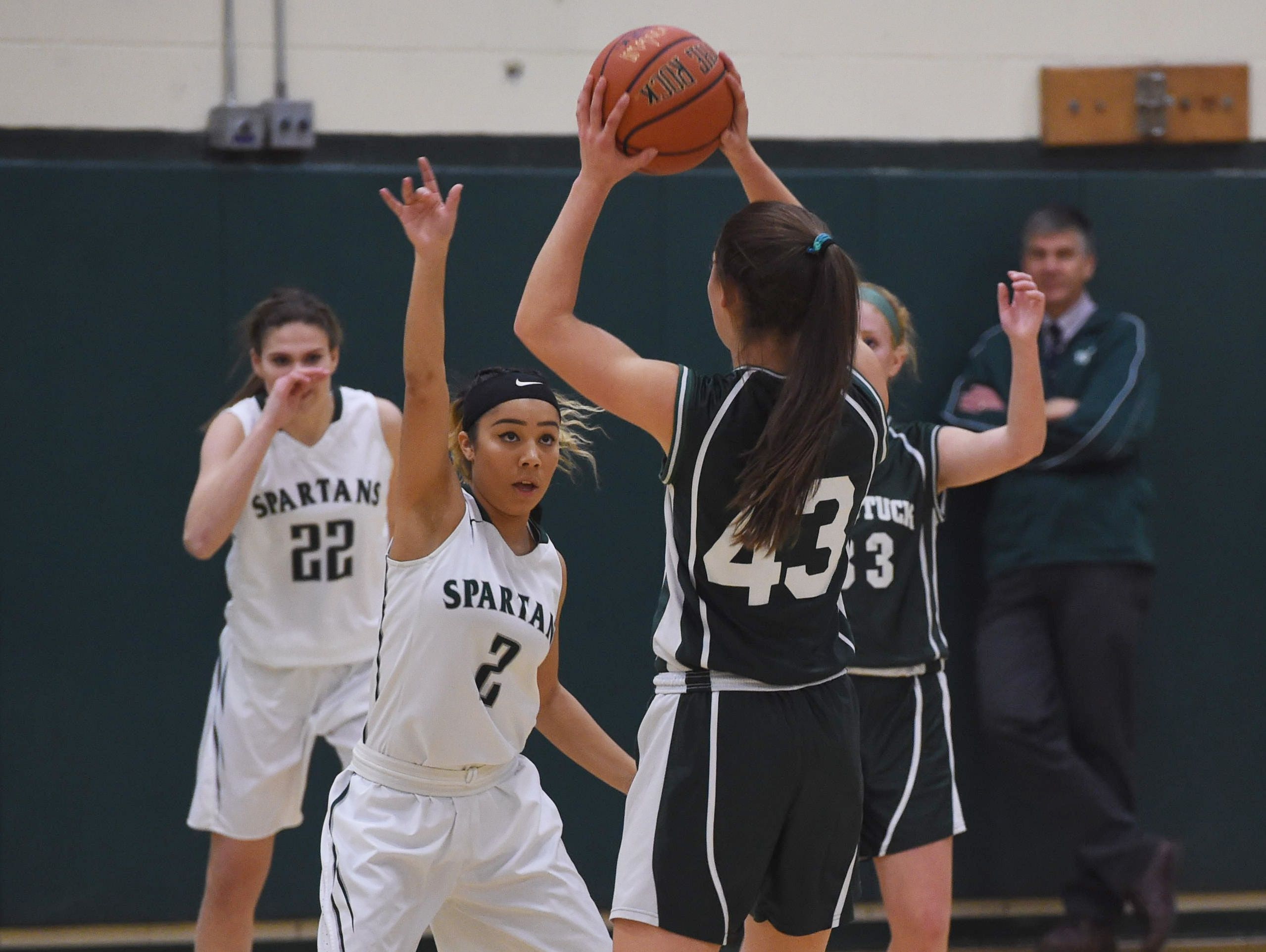 Webutuck's Taylor Edmundson, right, looks for an open teammate while Spackenkill's Isabelle Herrera, left, defends during Friday's game.