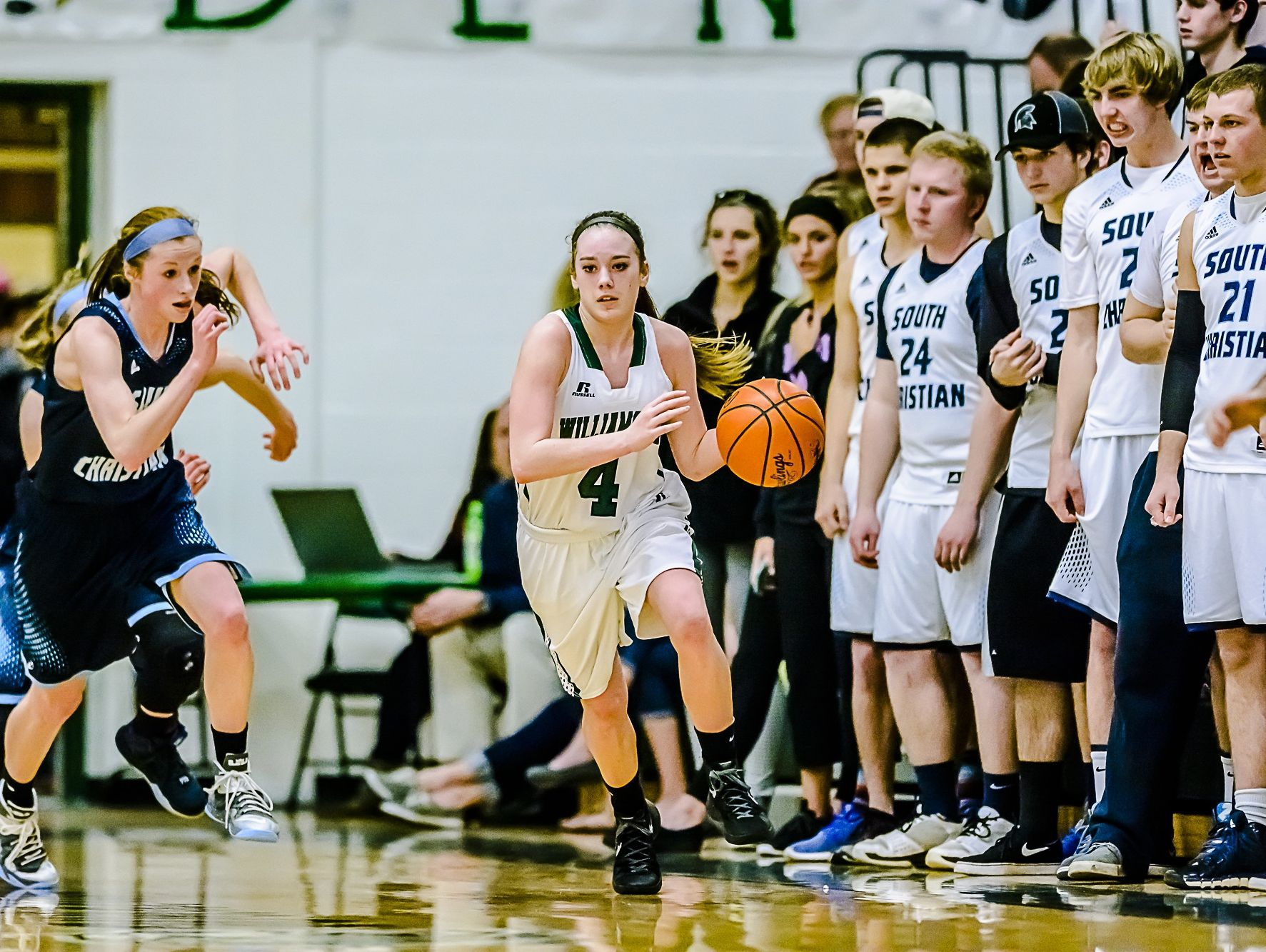 Maddie Waters, 4, of Williamston pushes the ball up the sideline after a Grand Rapids South Christian turnover during their Class B regional semifinal game last season. Watters, a three-year varsity starter, has helped the Hornets get out to an 8-1 record in the 2016-17 season.