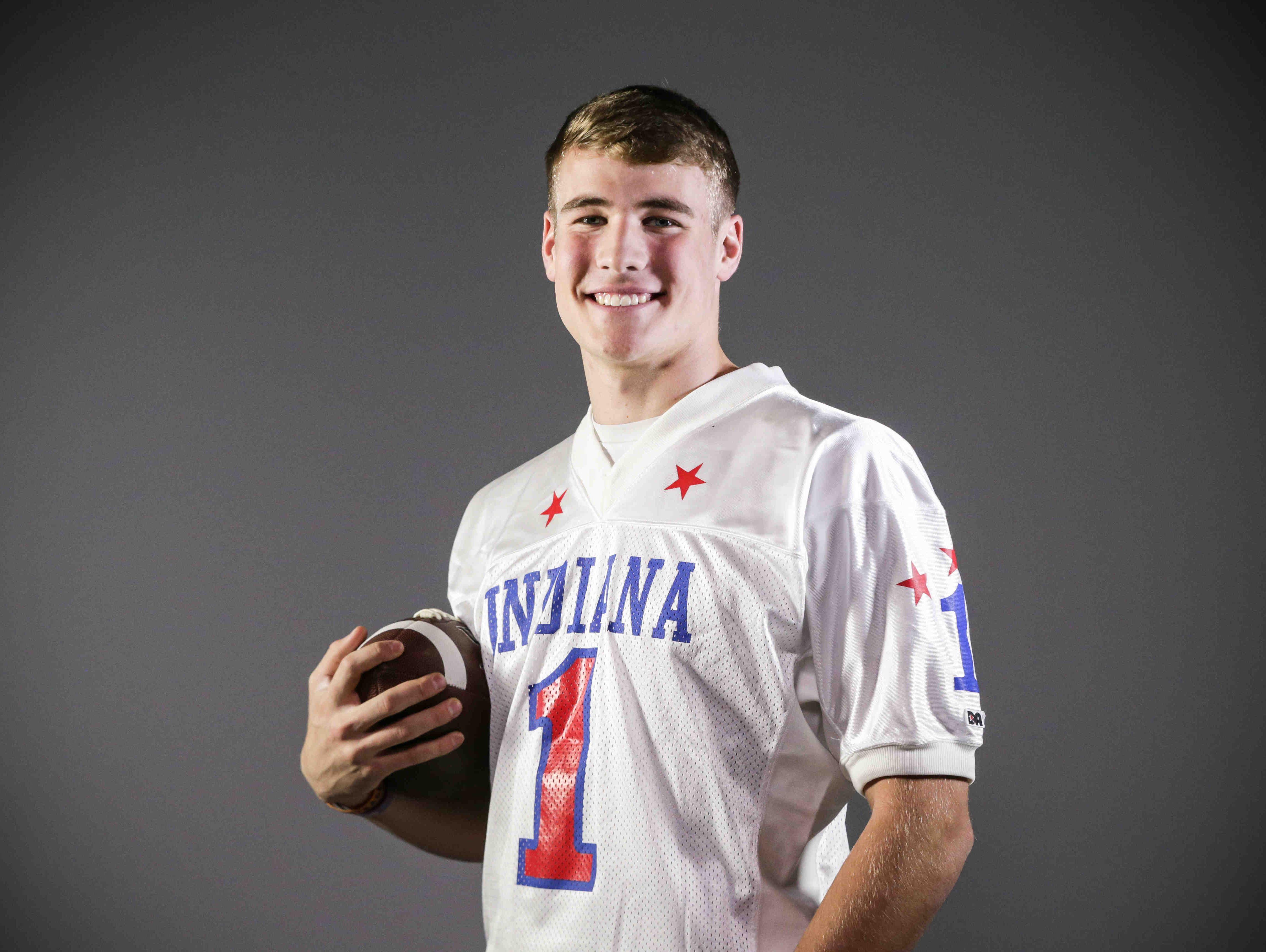 Brownsburg quarterback Hunter Johnson is named IndyStar Mr. Football 2016, Dec. 7, 2016.