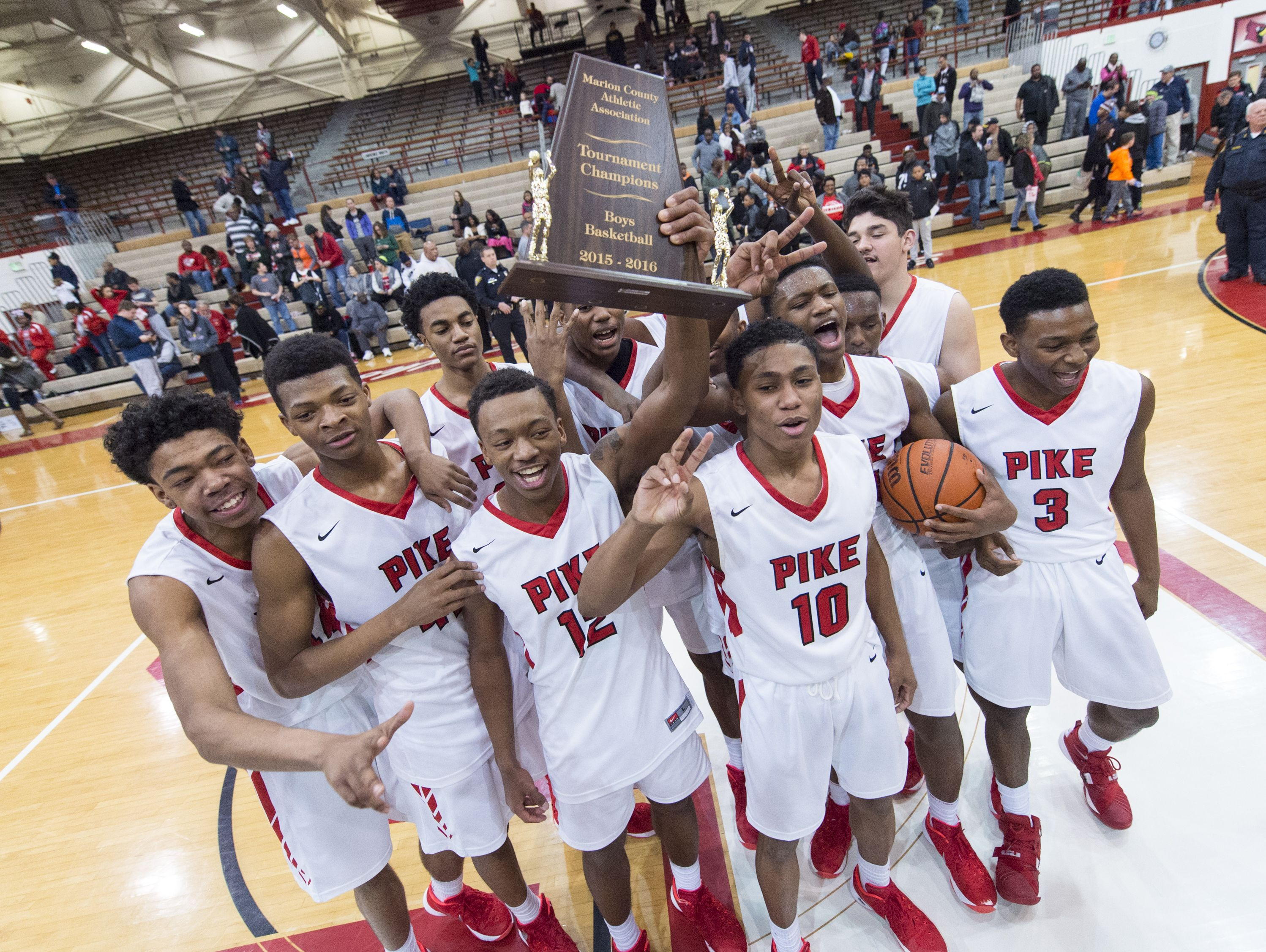 FILE — Can Pike win a third successive Marion County tournament title? The Red Devils will have their work cut out for them.