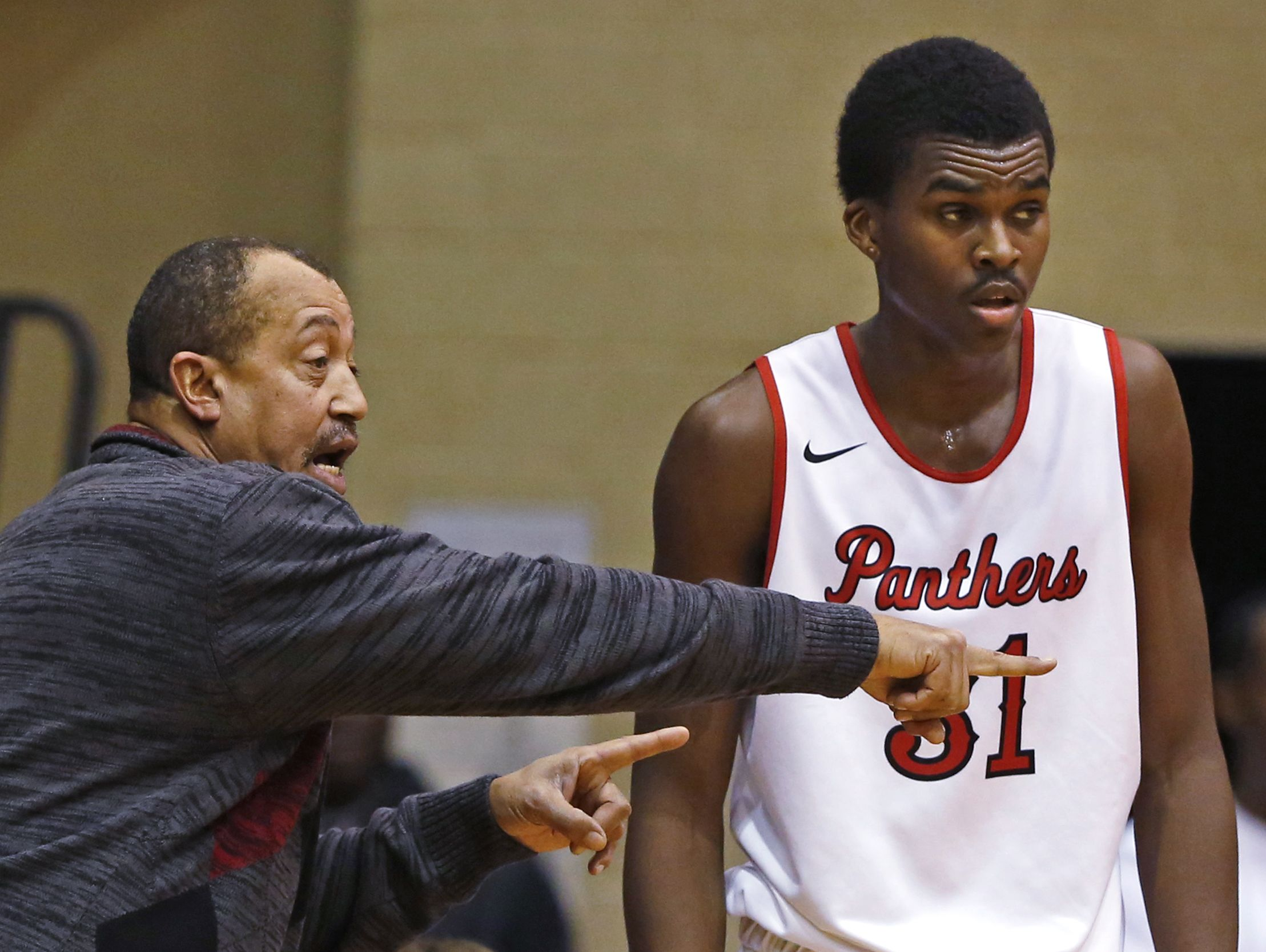 Doug Mitchell (left) and Kris Wilkes are eying North Central's first county title championship since 2012.