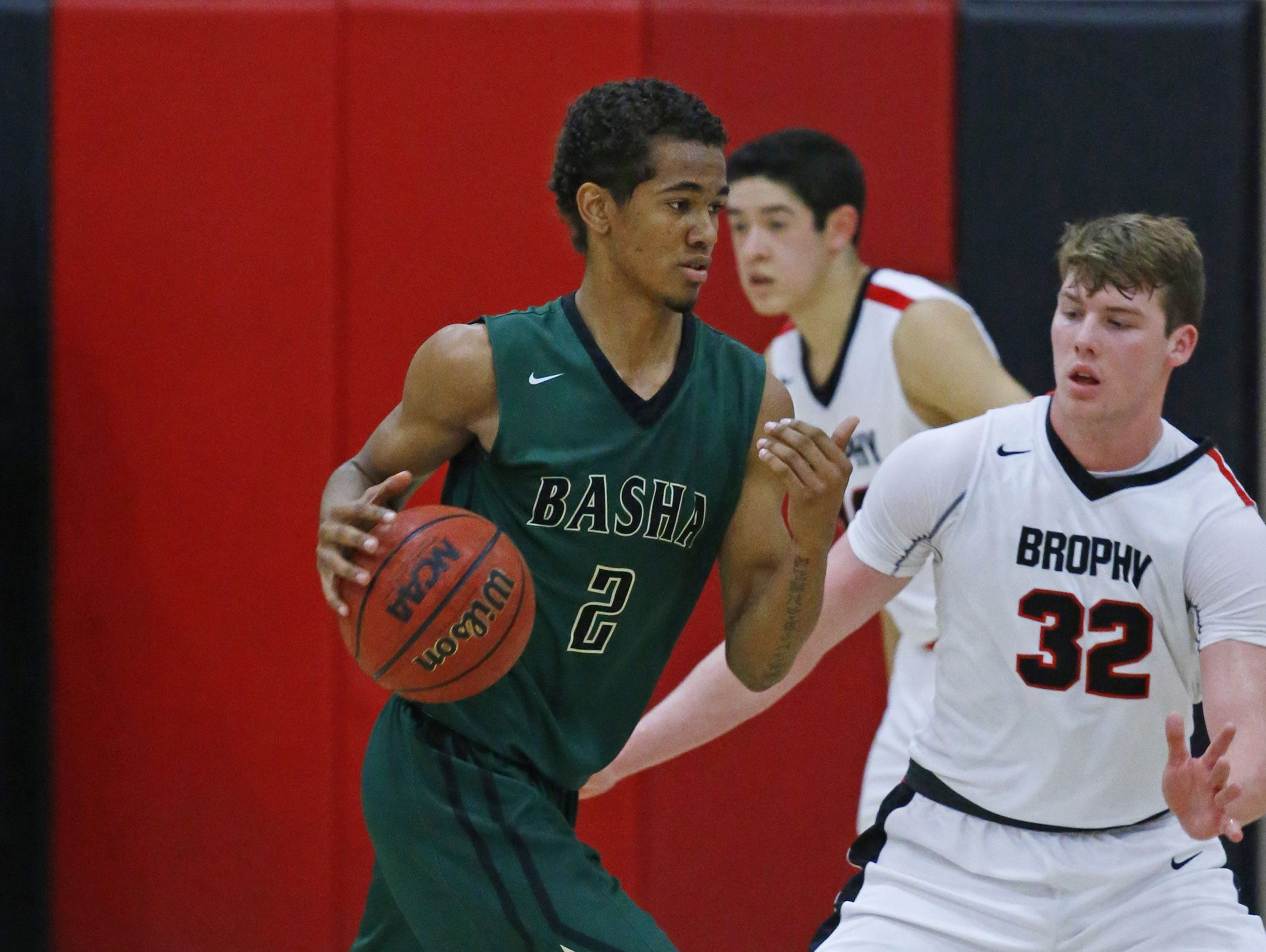 Basha's Terrell Brown works against Brophy College Prep's Matthew Kempton in their game Wednesday 4, 2017 in Phoenix, Arizona.