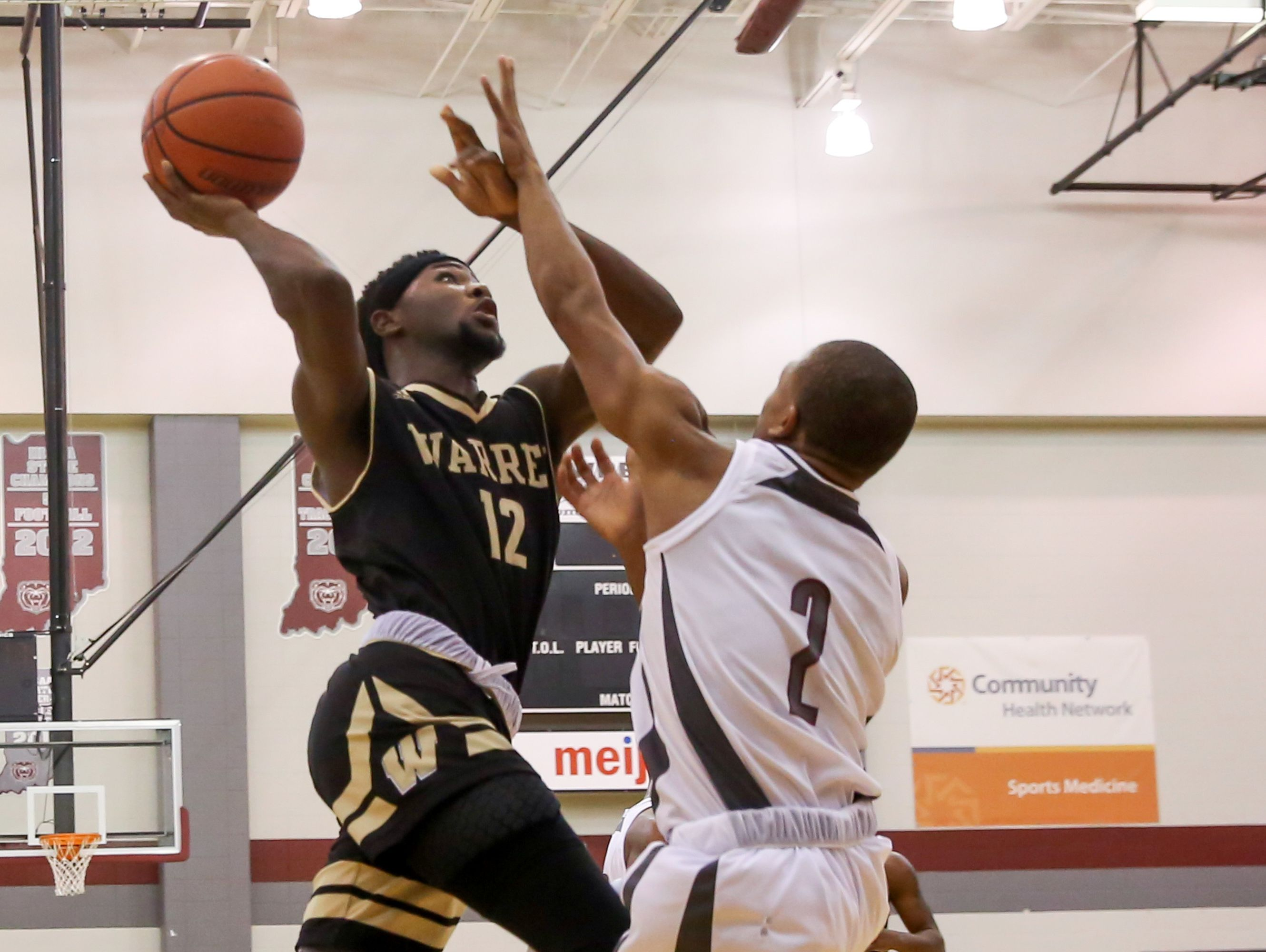 Mack Smith (12) scoreD a game-high 27 points in lifting Warren Central past Lawrence Central on Wednesday night.
