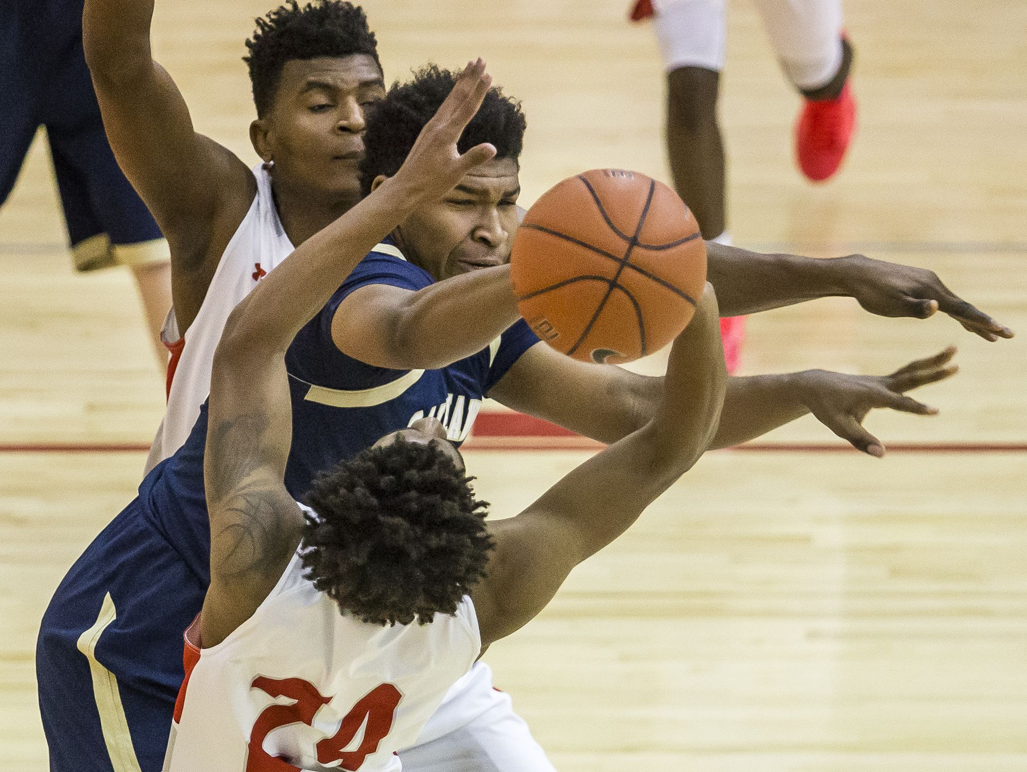 Smyrna's Azubuike Nwankwo and Iyair Hinson-Purnell (No. 24) force Salesianum's Tariq Ingraham to turn the ball over after a double team in the first half of Smyrna's 53-40 win over Salesianum at Smyrna High School on Tuesday night.