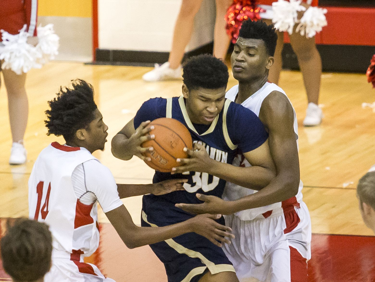 Salesianum's Tariq Ingraham is double teamed by Smyrna's Anthony Watson (No. 14) and Azubuike Nwankwoand in the first half of Smyrna's 53-40 win over Salesianum at Smyrna High School on Tuesday night.