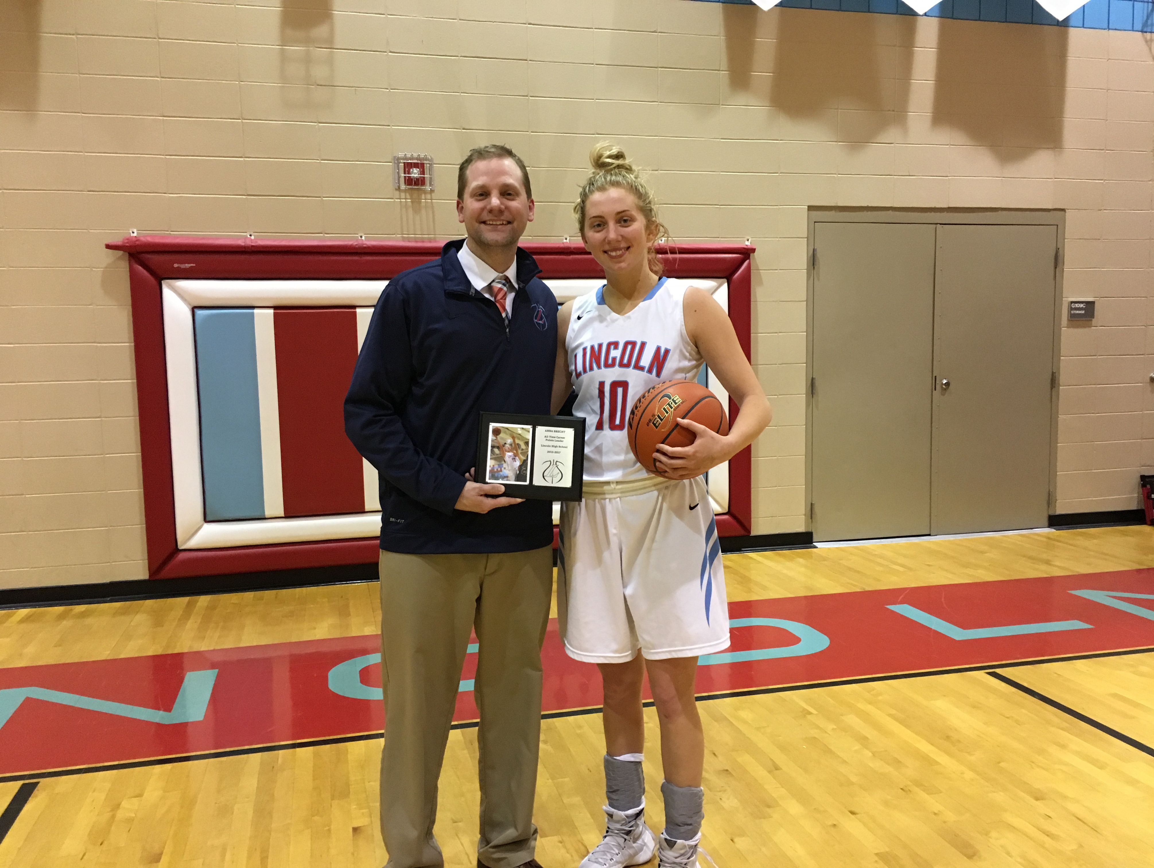 Anna Brecht poses with head coach Matt Daly after breaking Sioux Falls Lincoln's career scoring record on Tues., Jan. 10, 2017 against Yankton.