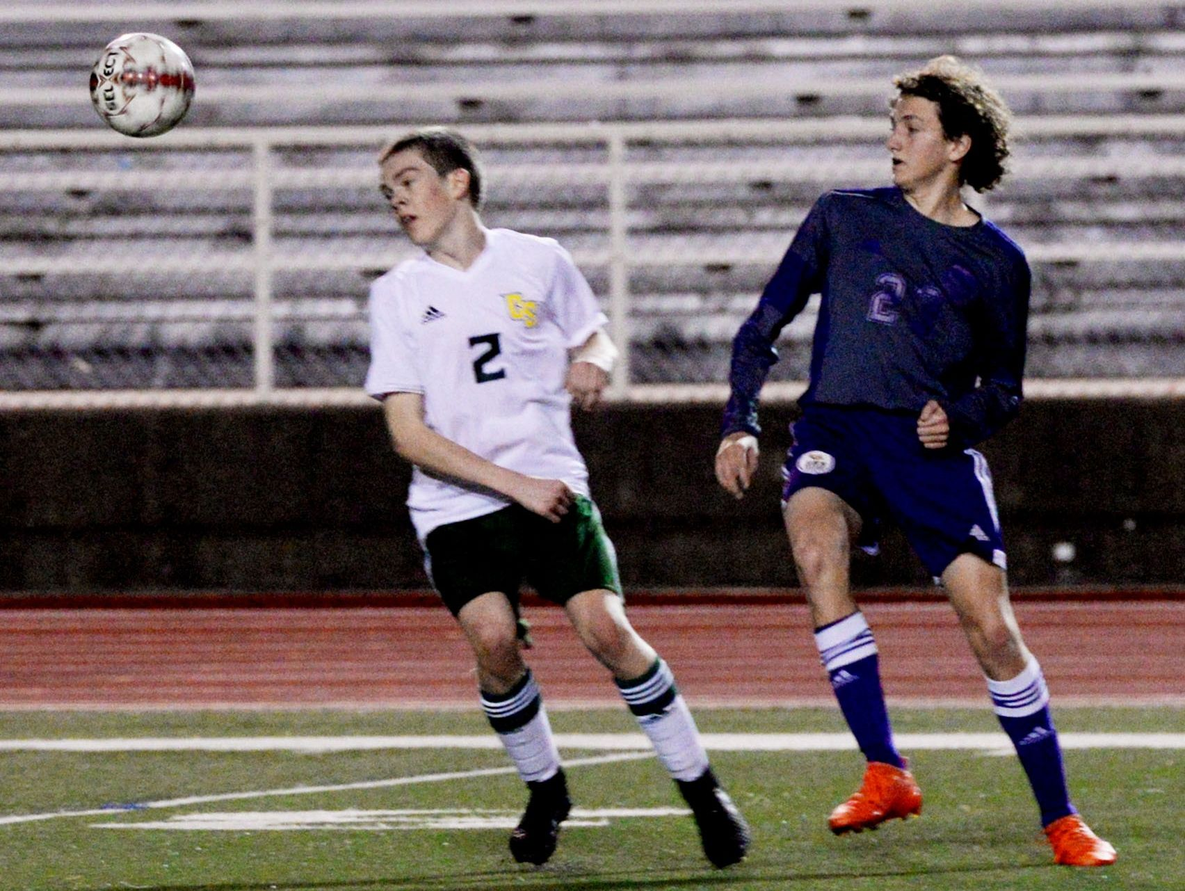 Captain Shreve's Gage Simpson and Benton's Isaac Ford during their game Tuesday evening.