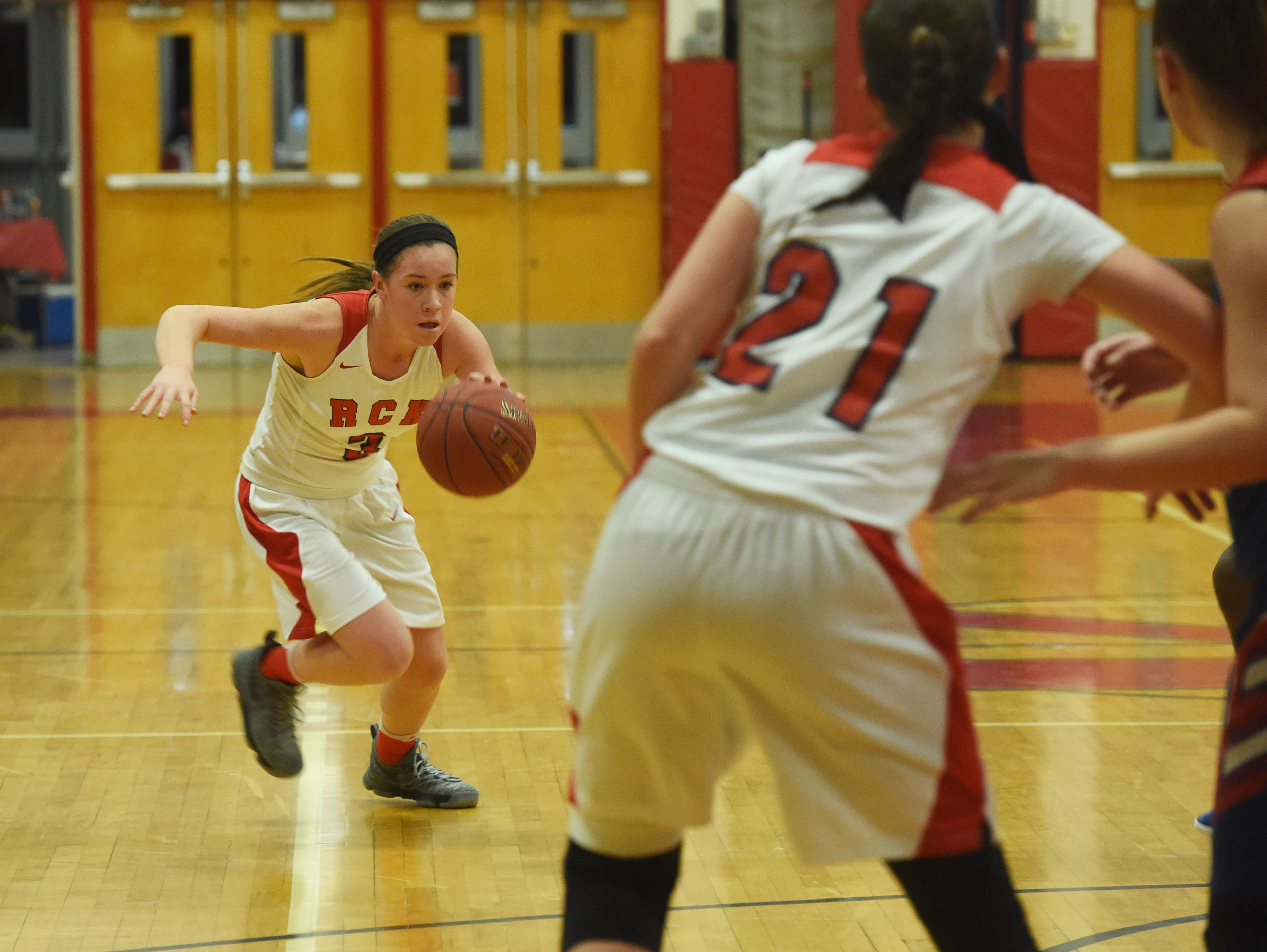 Ketcham's Katie Wall, left, takes the ball down the court during Wednesday's game against Carmel.