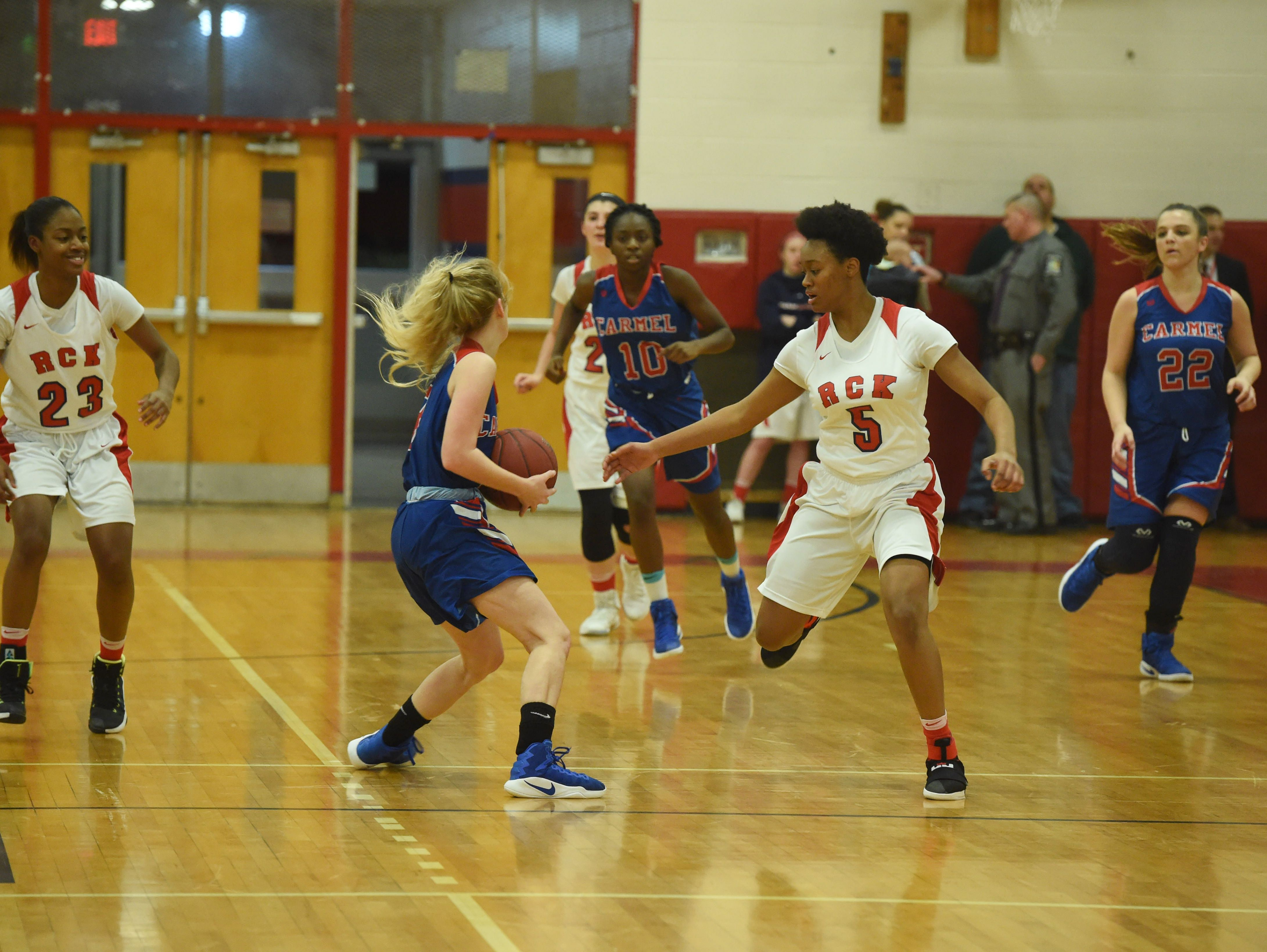 Ketcham's Jada Rencher, right, defends while Carmel's Kate Crawford, left, looks for an open teammate during Wednesday's game.