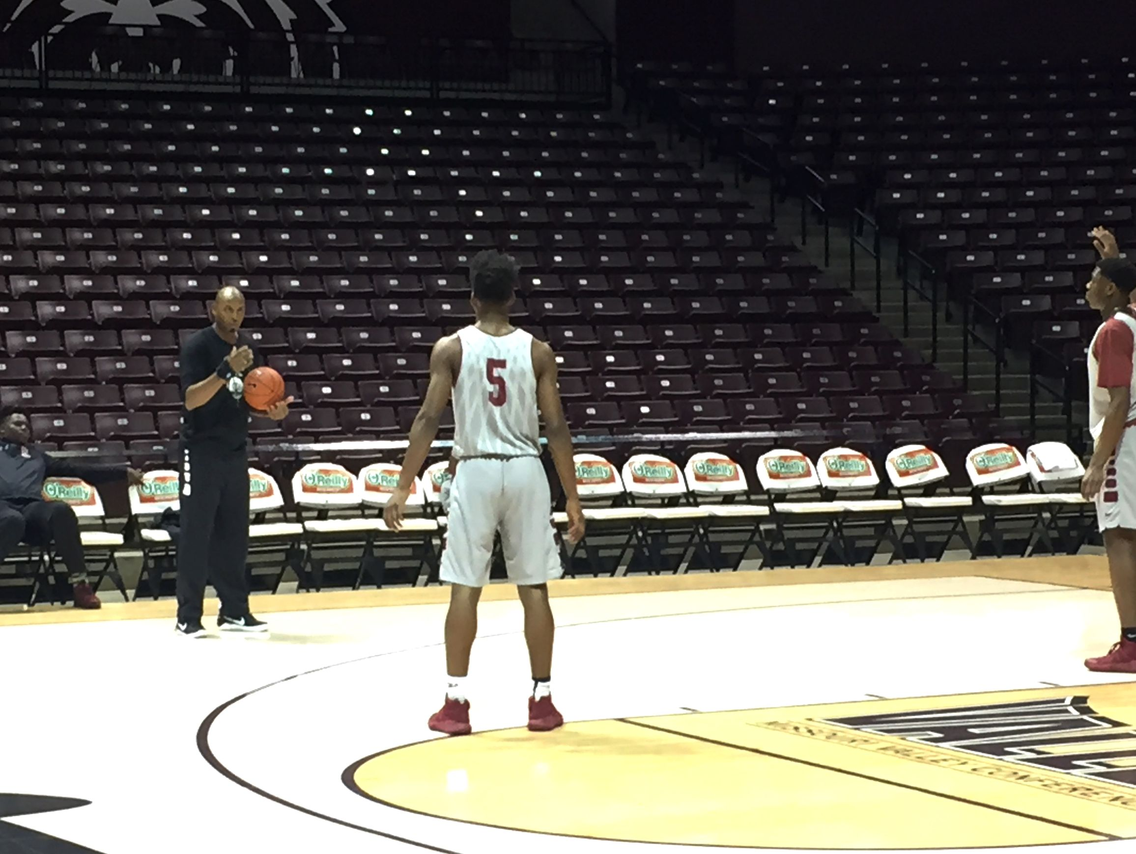 Memphis East High School boys basketball coach Anfernee Hardaway (left, with basketball) instructs two Mustangs players during a Wednesday shoot-around at JQH Arena prior to the 2017 Bass Pro Tournament of Champions.