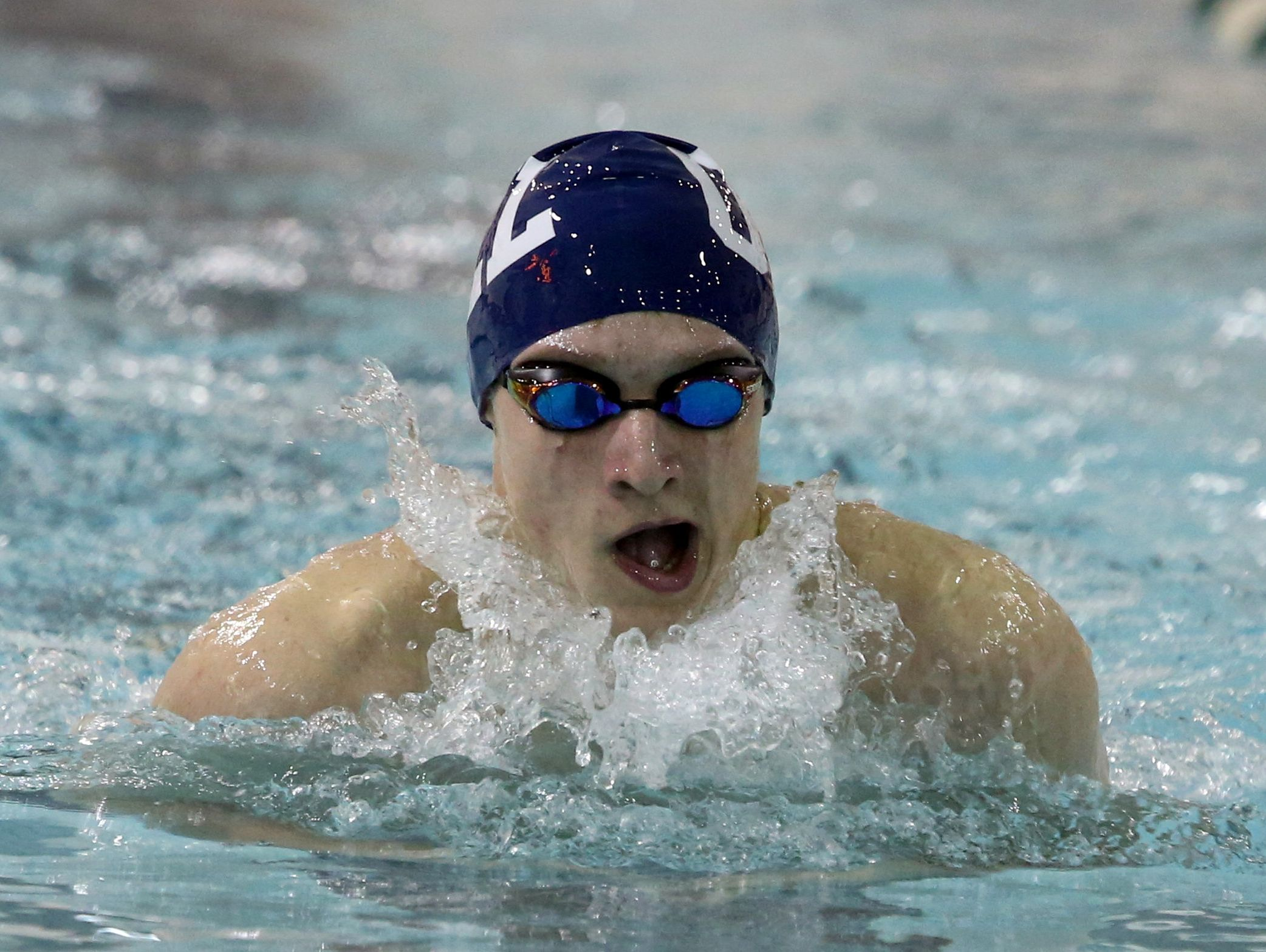 Christian Thomas of Our Lady of Lourdes swims the breaststroke leg of the 200 yard individual medley during a meet against Yorktown at the Mildred E. Strang Middle School in Yorktown Jan. 12, 2016.