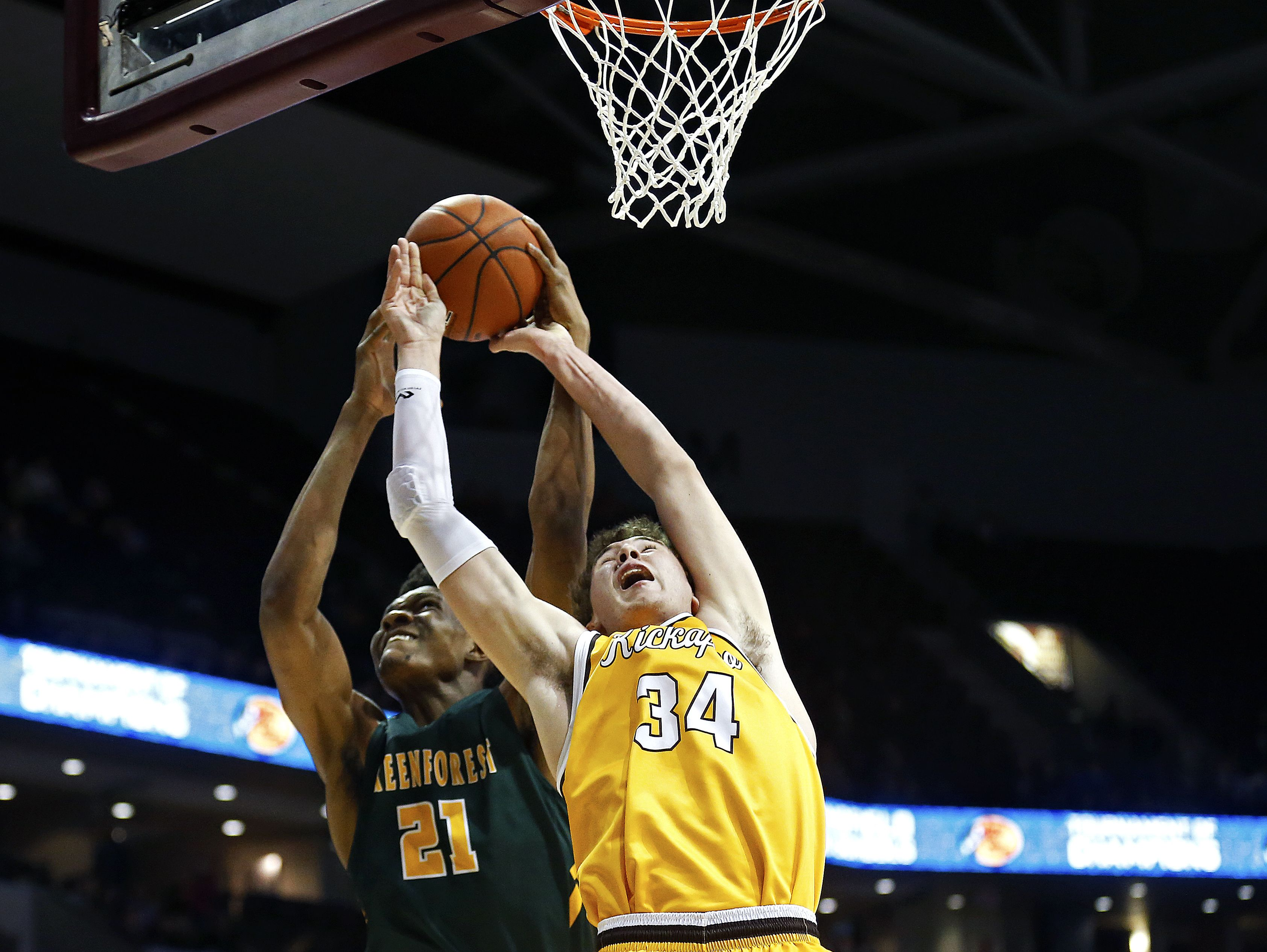 Greenforest Christian Academy (Decatur, Ga.) center Ikey Obiagu (21) and Kickapoo High School (Springfield, Mo.) center Jared Ridder (34) fight for a rebound during first quarter action of the 2017 Bass Pro Tournament of Champions high school basketball game between the Kickapoo High School Chiefs (Springfield, Mo.) and the Greenforest Christian Academy Eagles (Decatur, Ga.) at JQH Arena in Springfield, Mo. on Jan. 13, 2017.