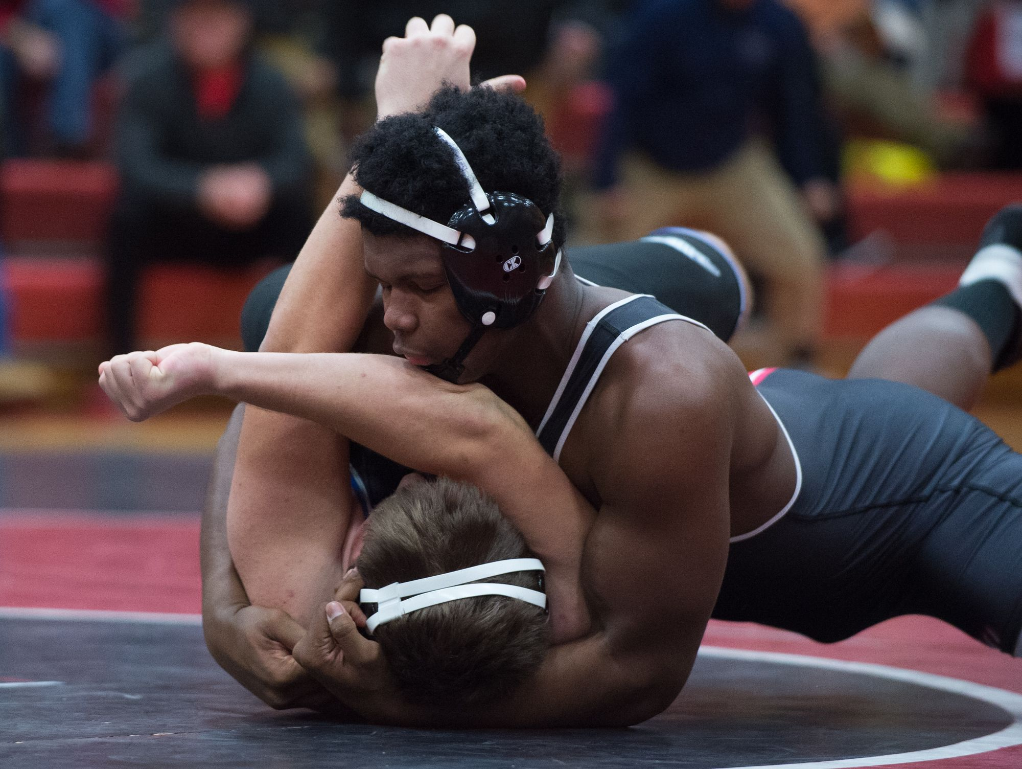 William Penn's Charlie Hope (top) pins Wilmington Charter's Kyle Lank (bottom) in the 285 pound final match to take a 39-31 win over Charter at William Penn High School.