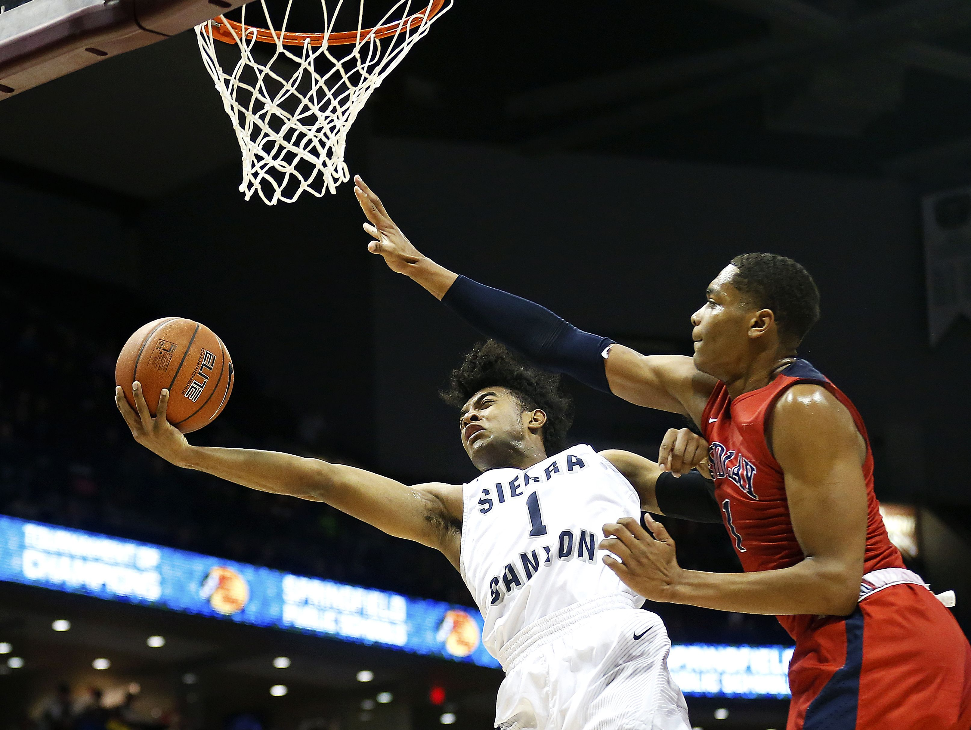 Sierra Canyon School guard Remy Martin (1) tries to shoot past Findlay Prep forward PJ Washington (1) during quarter action of the 2017 Bass Pro Tournament of Champions high school basketball game between the Sierra Canyon School Blazers (Chatsworth, Calif.) and the Findlay Prep Pilots (Las Vegas, Nev.) at JQH Arena in Springfield, Mo. on Jan. 13, 2017.