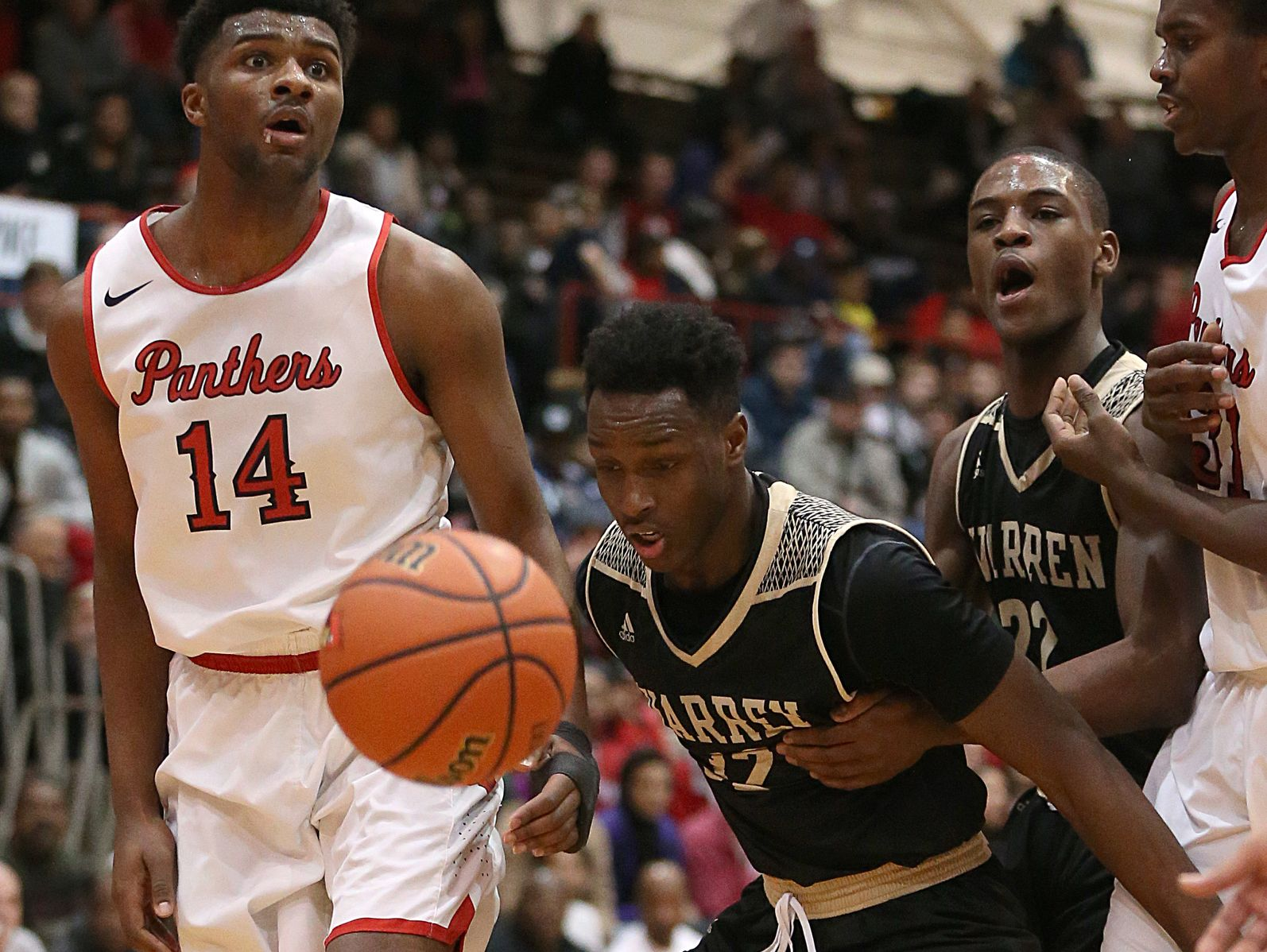 North Central Panthers Emmanuel Little (14) reacts to being called for a foul on Warren Central Warriors Mack Smith (32) during second half action between Warren Central and North Central in Marion County boys semifinals, at Southport High School, Indianapolis, Friday, Jan. 13, 2016. North Central won, 69-65.