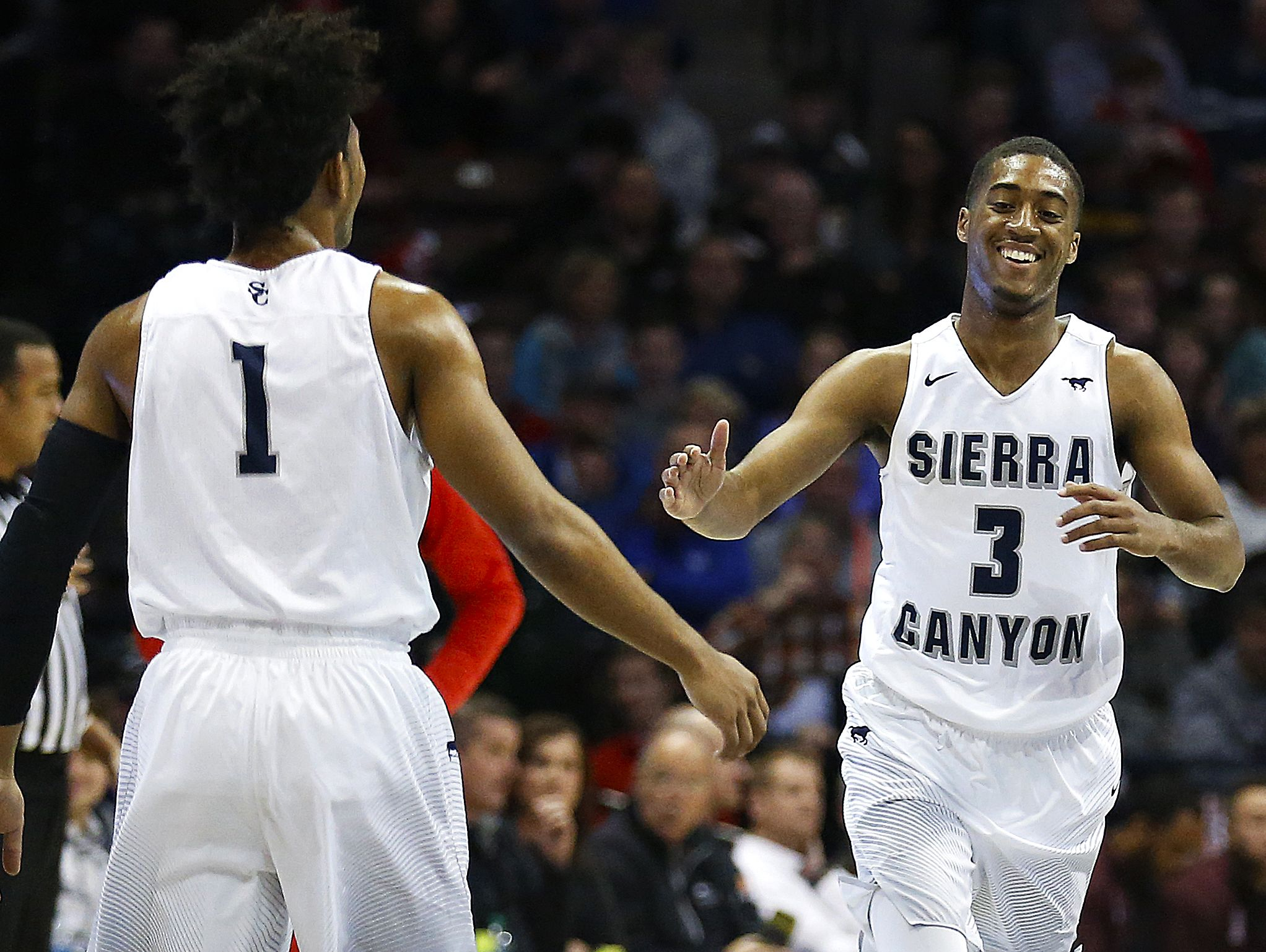 Sierra Canyon School (Chatsworth, Calif.) guard Remy Martin (1) and guard Terrance McBride (3) celebrate during first quarter action of the 2017 Bass Pro Tournament of Champions high school basketball game between the Sierra Canyon School Trailblazers (Chatsworth, Calif.) and the Findlay Prep Pilots (Las Vegas, Nev.) at JQH Arena in Springfield, Mo. on Jan. 13, 2017. The Sierra Canyon School Trailblazers won the game 76-47.