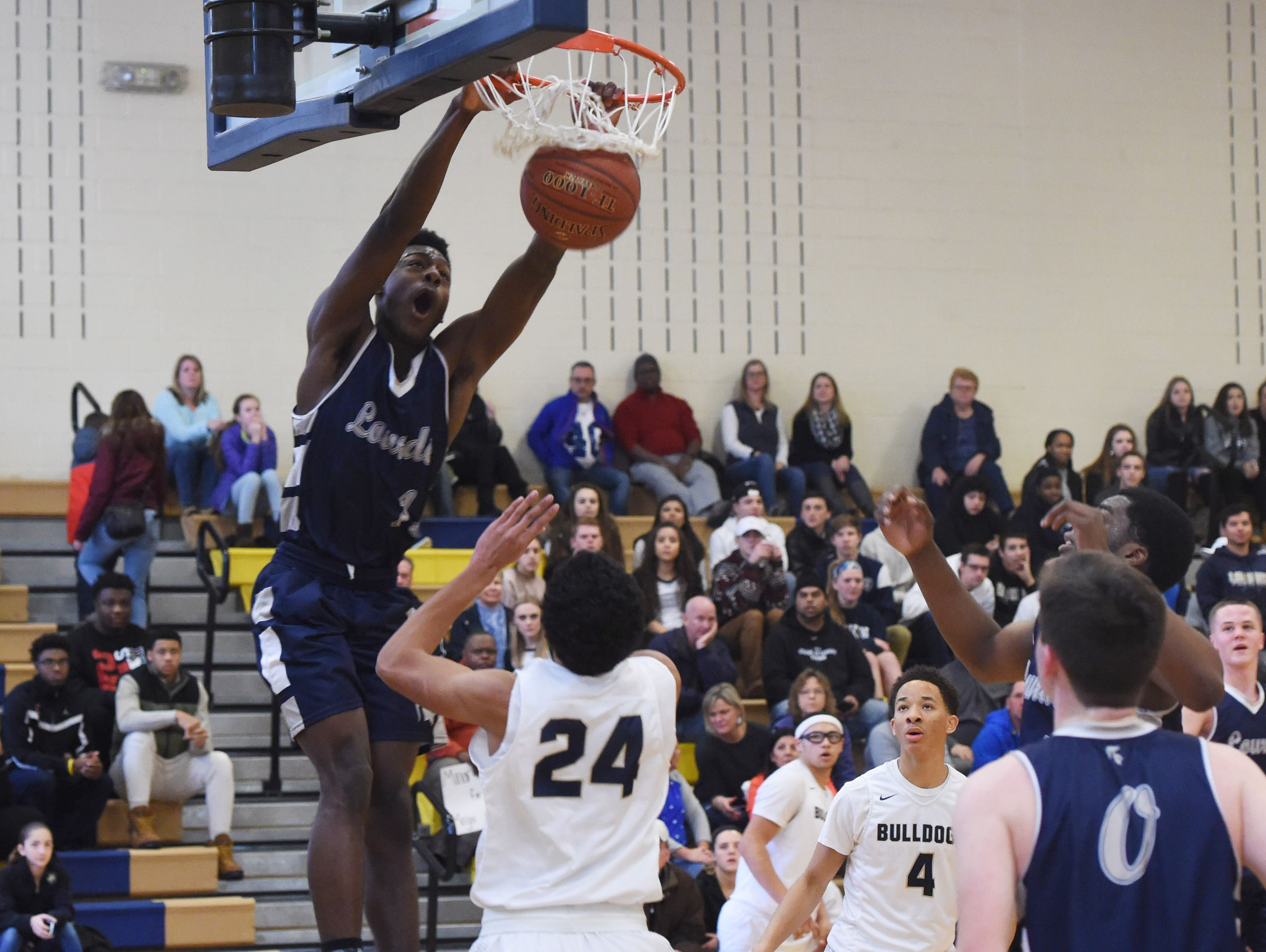 Lourdes' Kevin Townes lands a dunk during Saturday's game against Beacon.