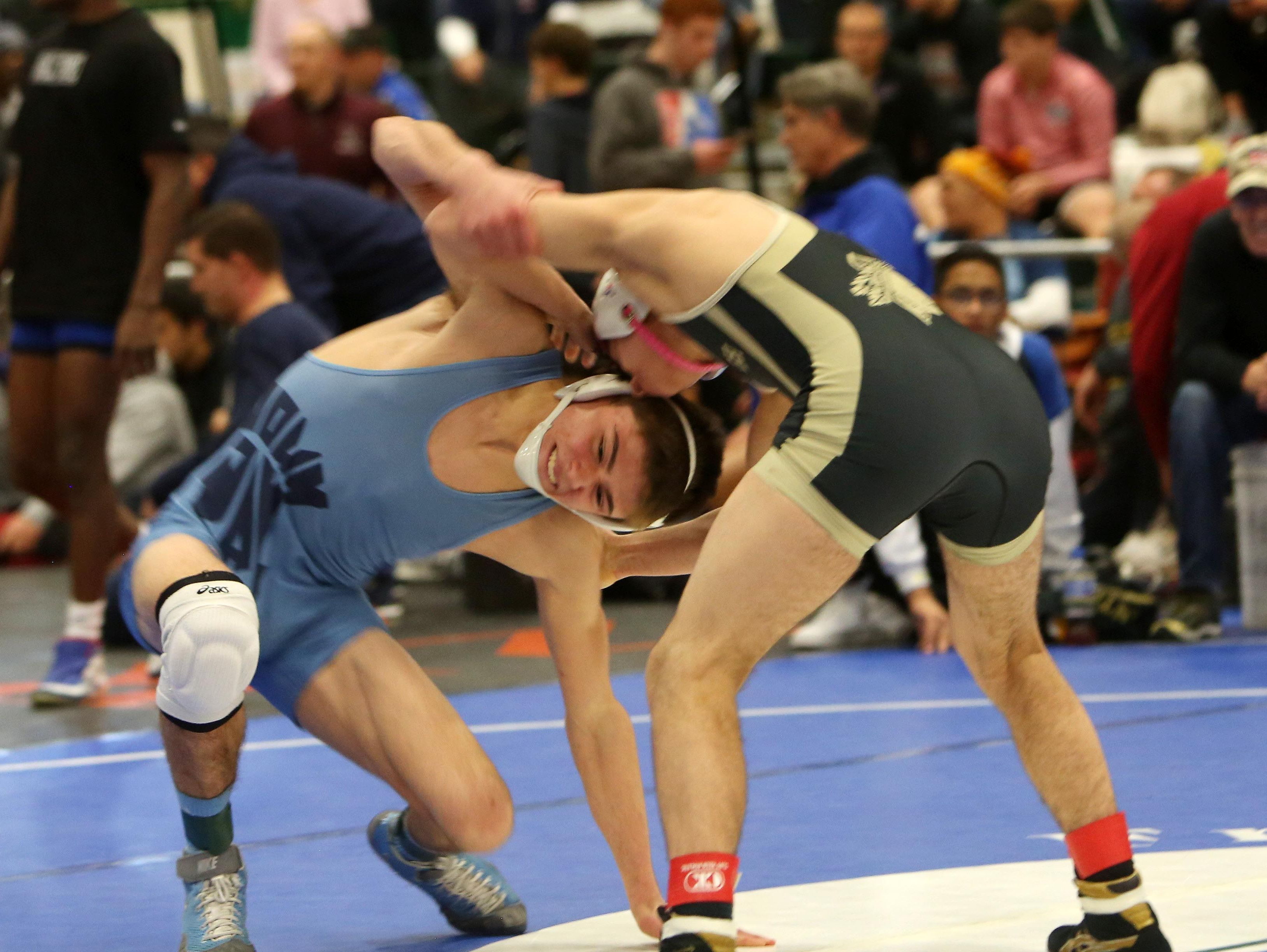 John Jay East Fishkill's Randy Earl and Wantagh's Justin Vines wrestle in the semifinals of the 126-pound weight class during the Eastern States Classic Wrestling Tournament at Sullivan Community College in Loch Sheldrake, N.Y. Jan. 14, 2017. Vines won the match, with Earl taking 5th place and also winning his 200th career win.