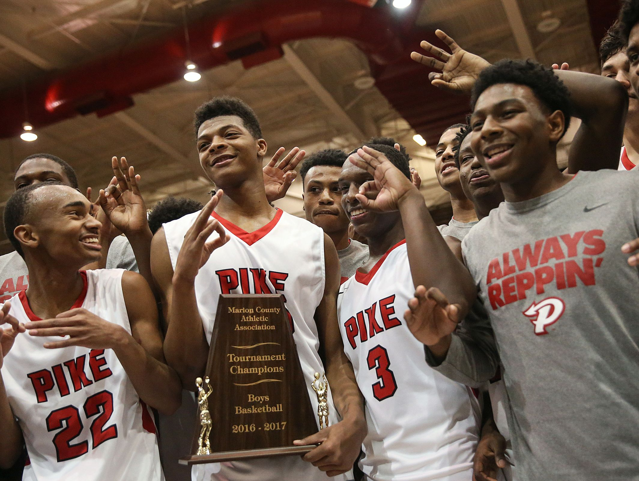 The Pike Red Devils pose with the trophy after Pike defeated North Central in Marion County boys finals, at Southport High School, Indianapolis, Saturday, Jan. 14, 2017.