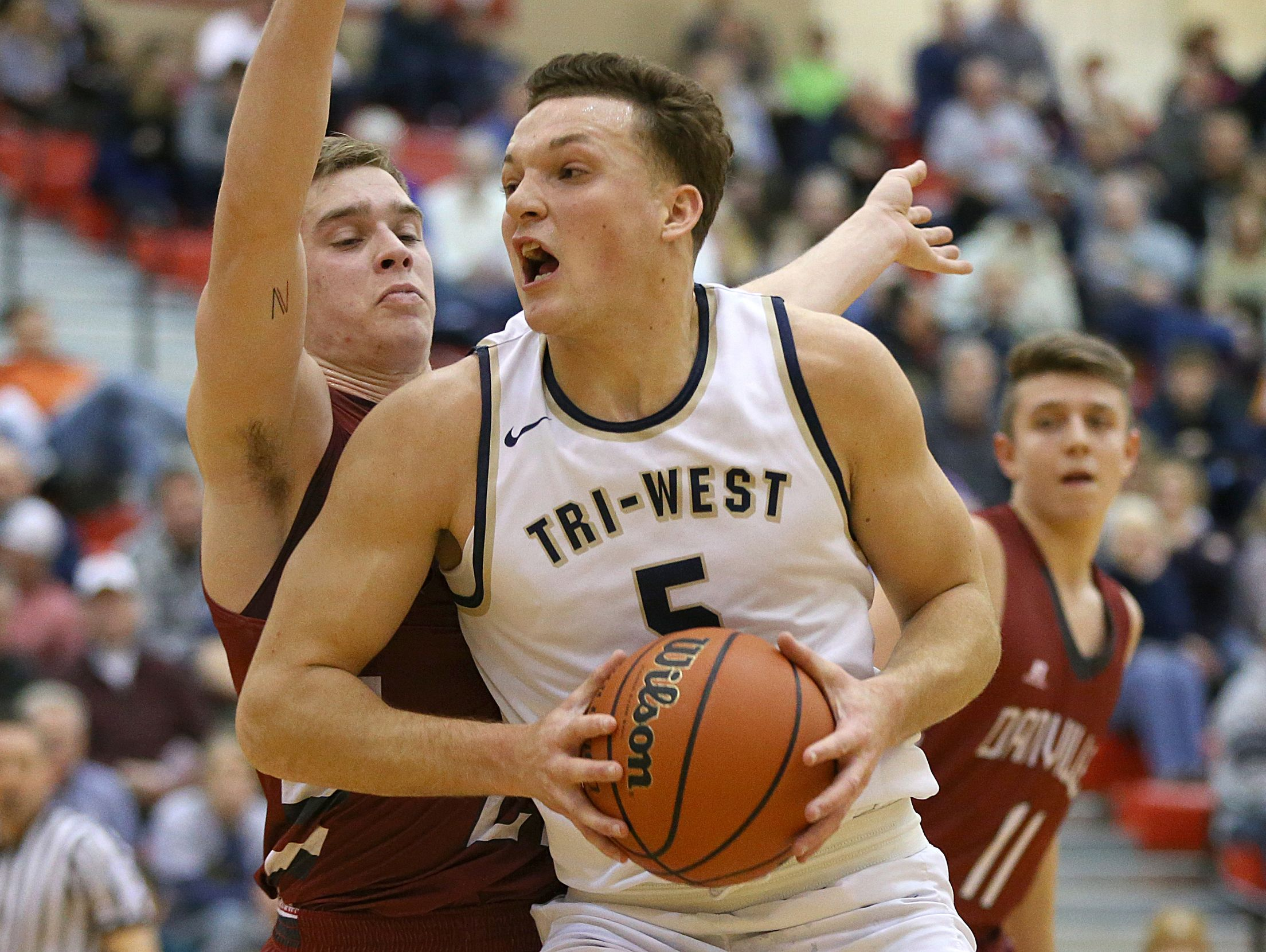Tri-West Bruins forward Peyton Hendershot (5) boxed out a player Jan. 6 during the Hendricks County boys semifinals at Plainfield High School.