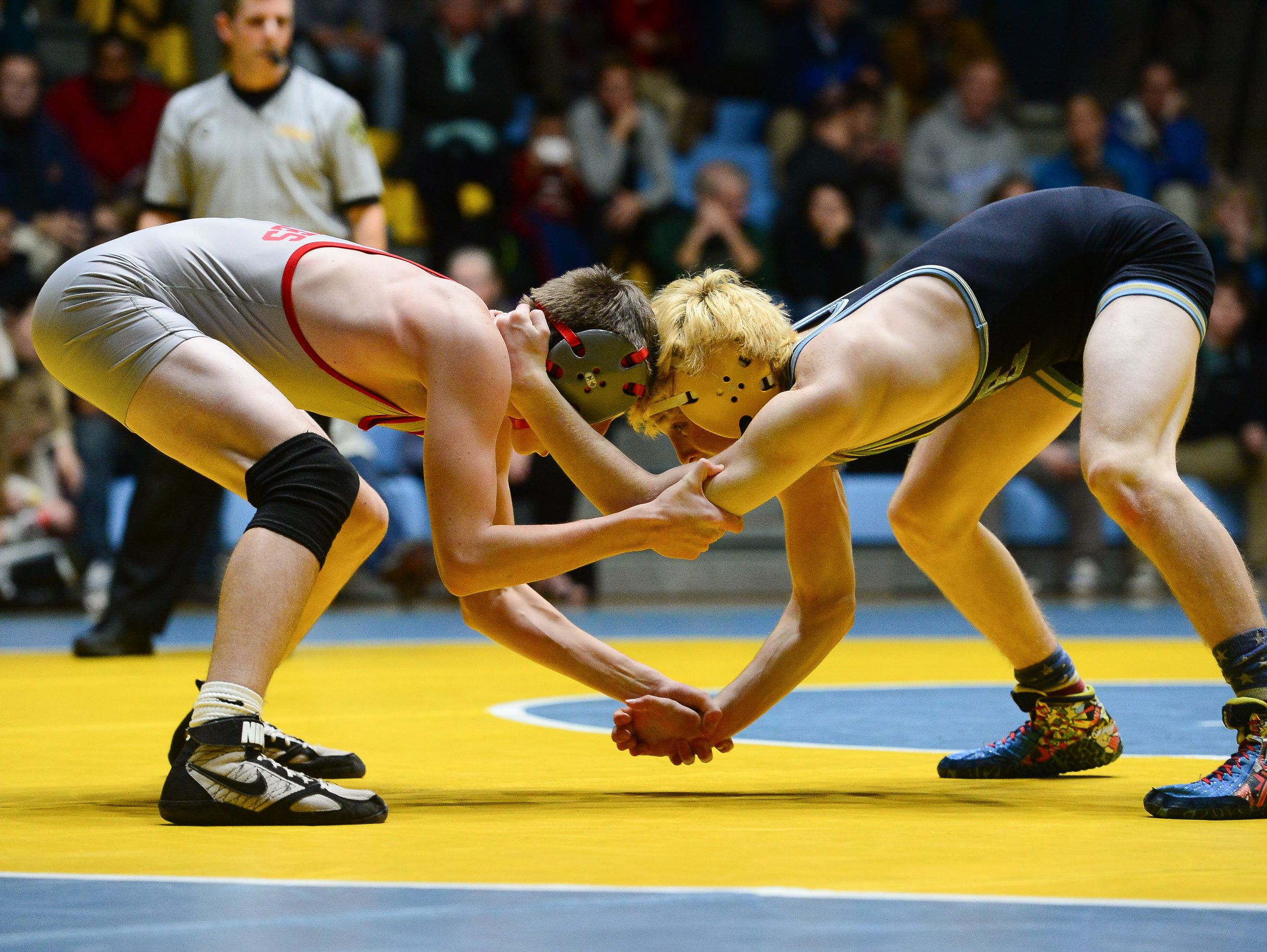 Cape's Anthony Caruso matches up against Smyrna's Nick Natarcola during the 120lb match up at Cape Henlopen High School on Wednesday, Jan. 18, 2017.