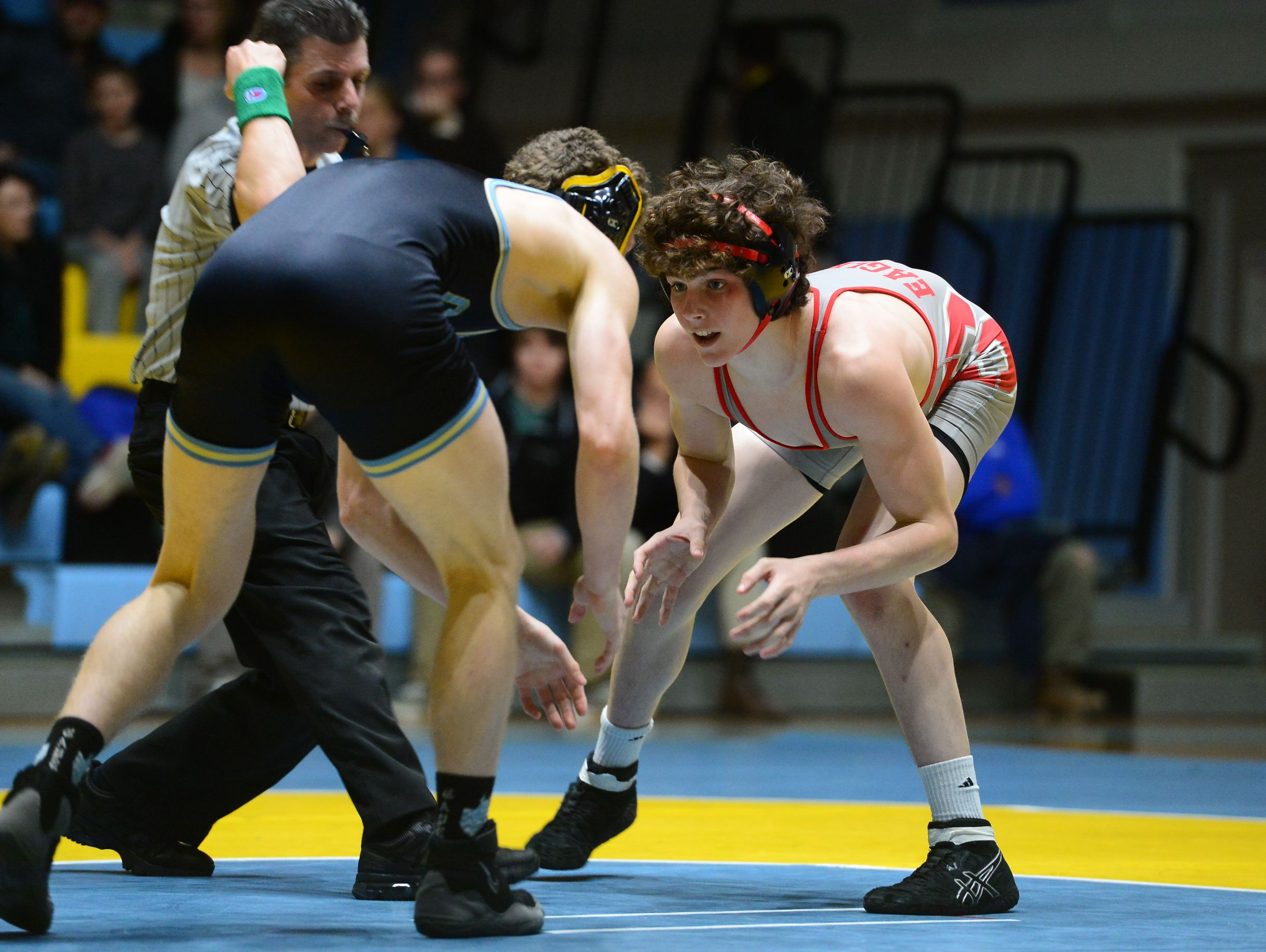 Cape's Vinnie Diego matches up against Smyrna's JT Davis during the 138lb match up at Cape Henlopen High School on Wednesday, Jan. 18, 2017.