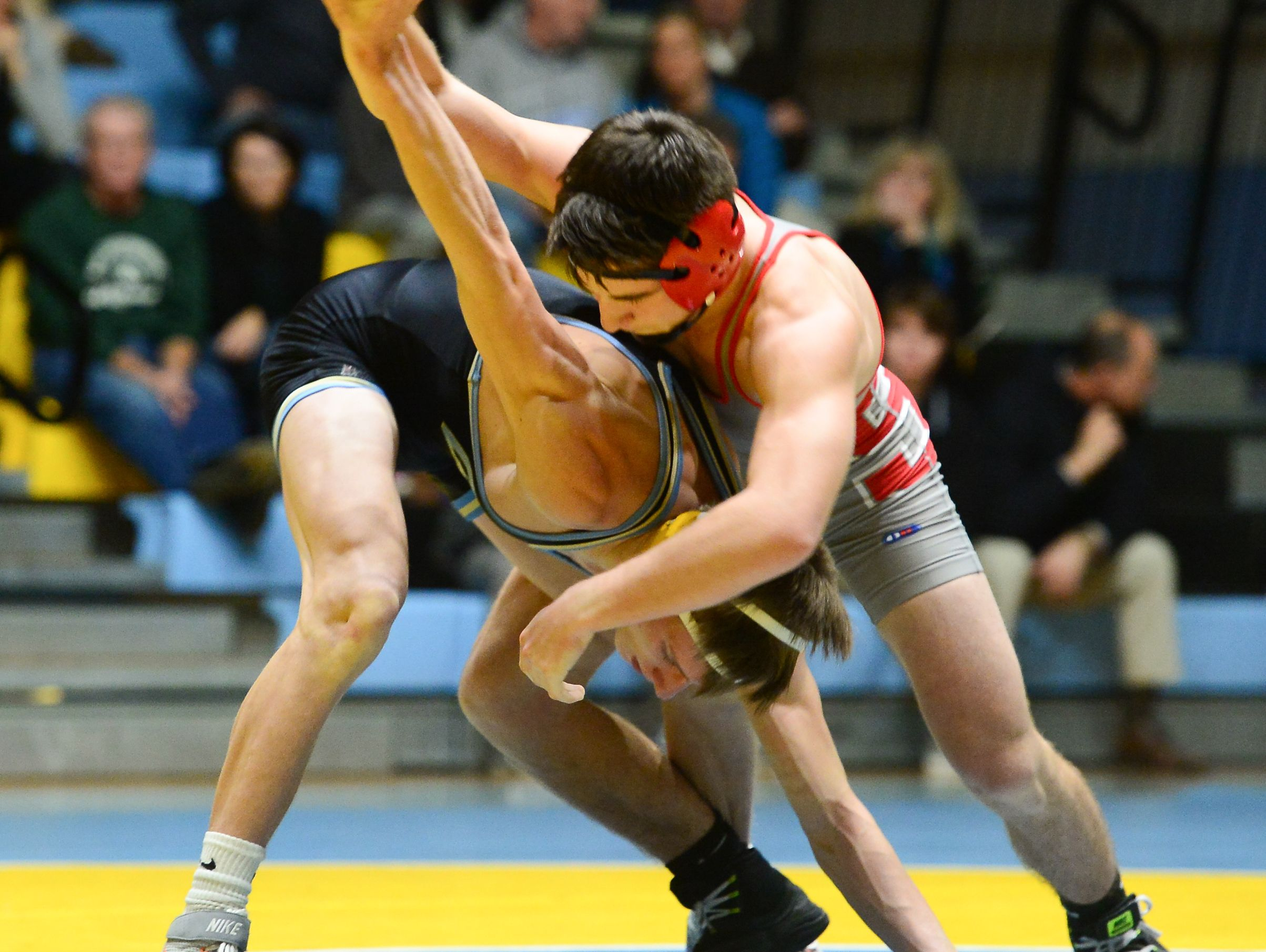 Cape's Max Norquest matches up against Smyrna's Greg Baum during the 132lb match up at Cape Henlopen High School on Wednesday, Jan. 18, 2017.