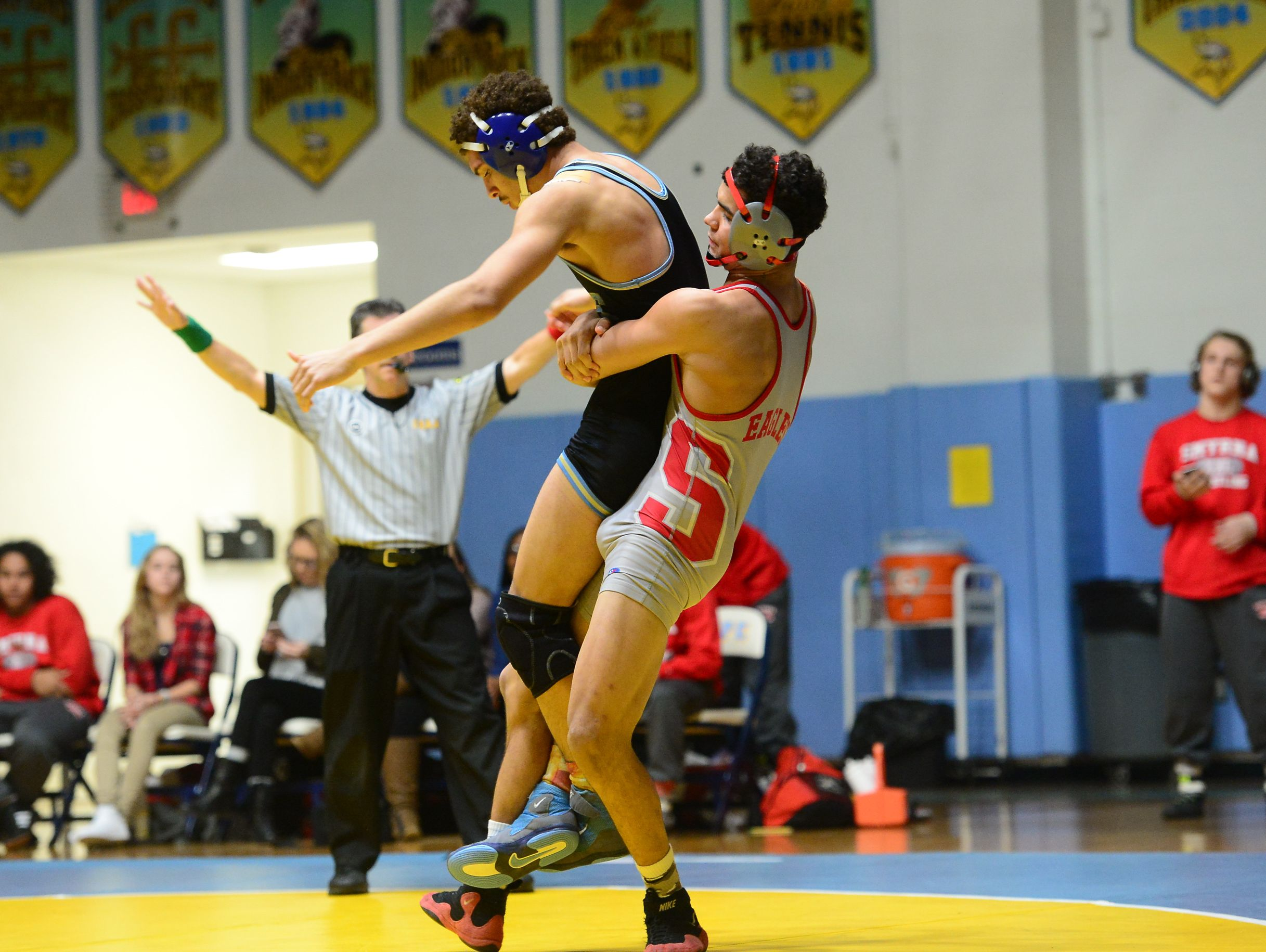 Cape's Dante Jacquet matches up against Smyrna's Nate Bryant during the 152lb match up at Cape Henlopen High School on Wednesday, Jan. 18, 2017.