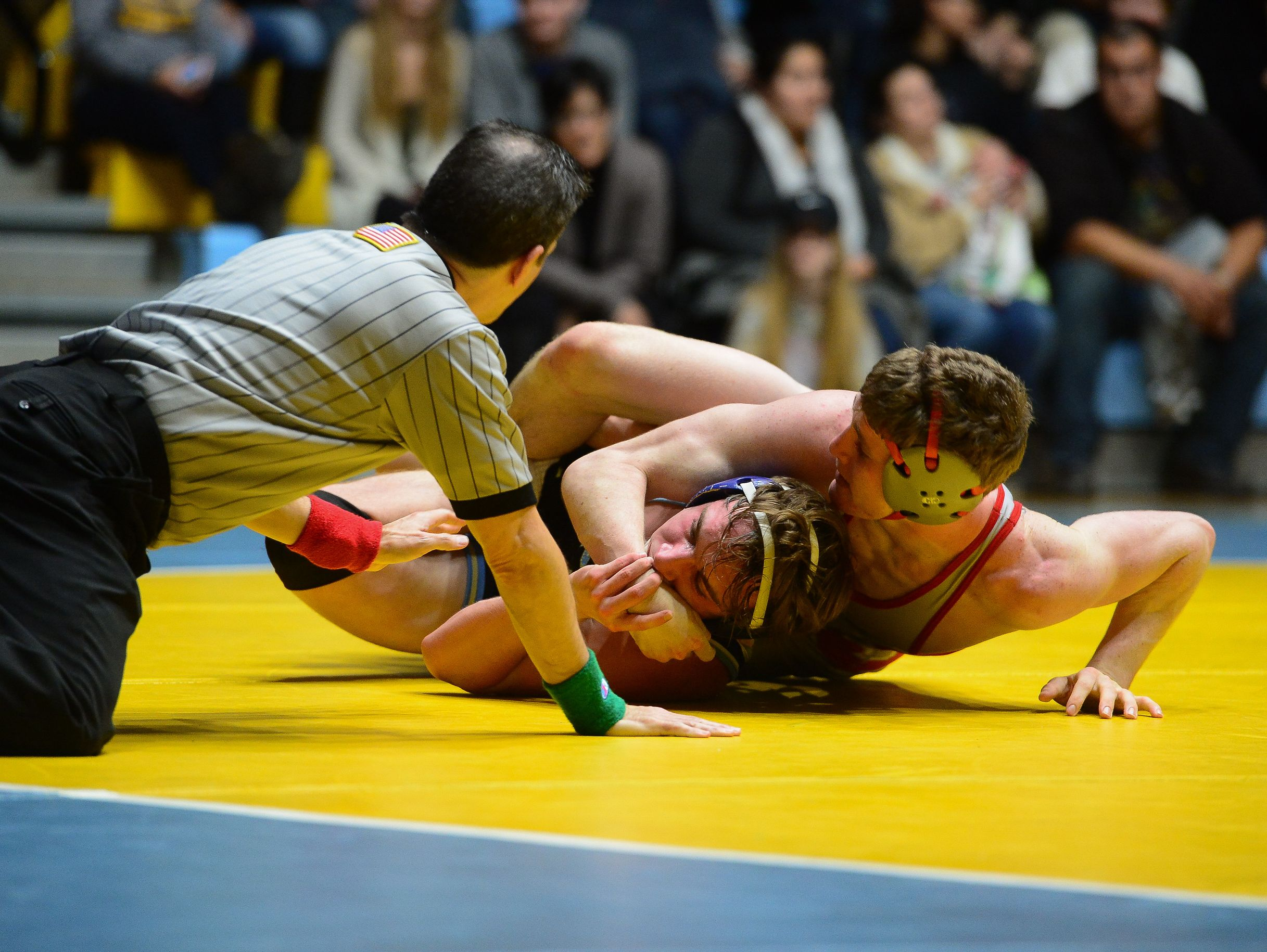 Cape's Zeke Bean matches up against Smyrna's Chase Archangelo during the 145lb match up at Cape Henlopen High School on Wednesday, Jan. 18, 2017.