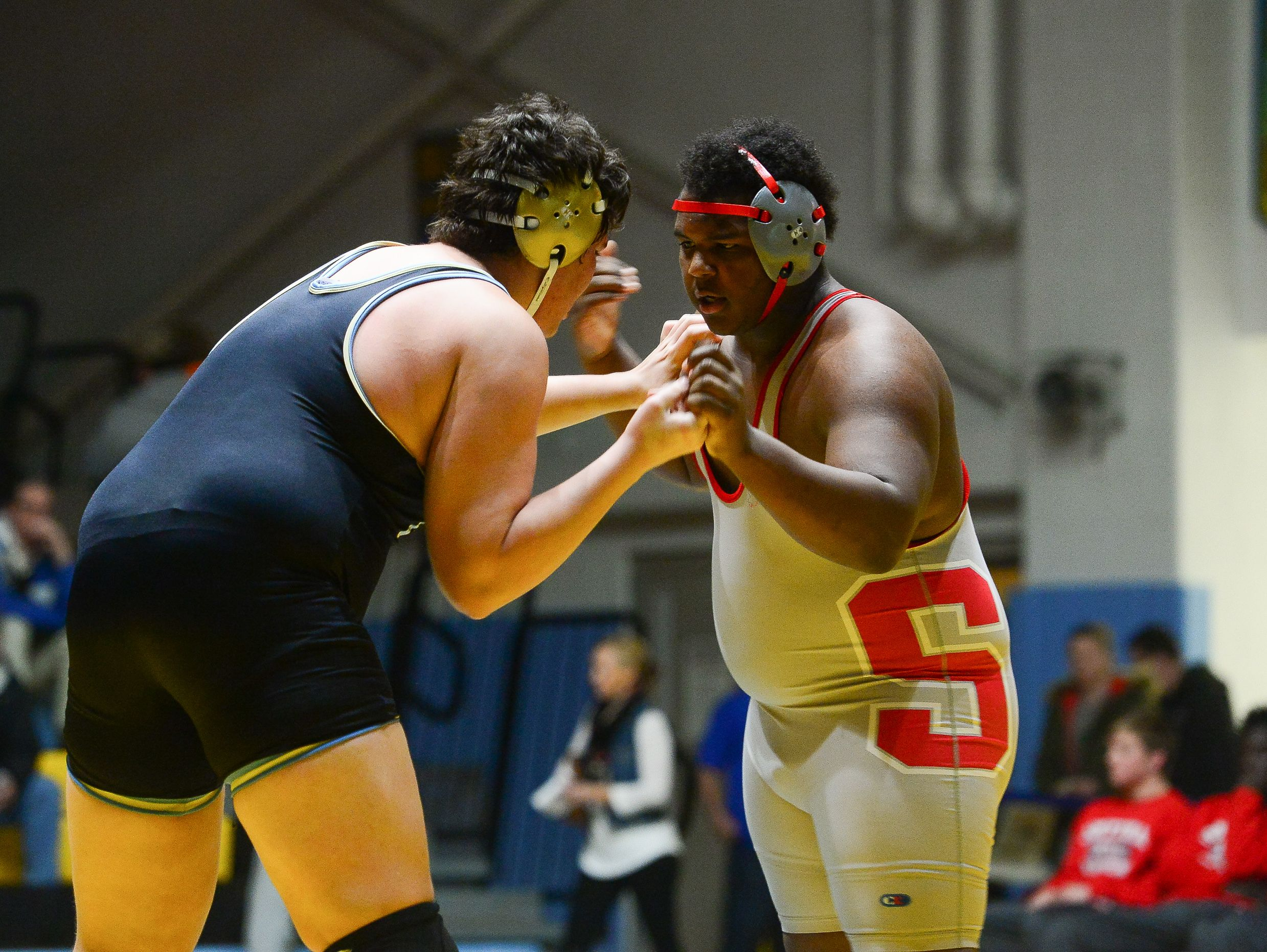 Cape's Zach Flores matches up against Smyrna's Elijah Taylor during the 285lb match up at Cape Henlopen High School on Wednesday, Jan. 18, 2017.