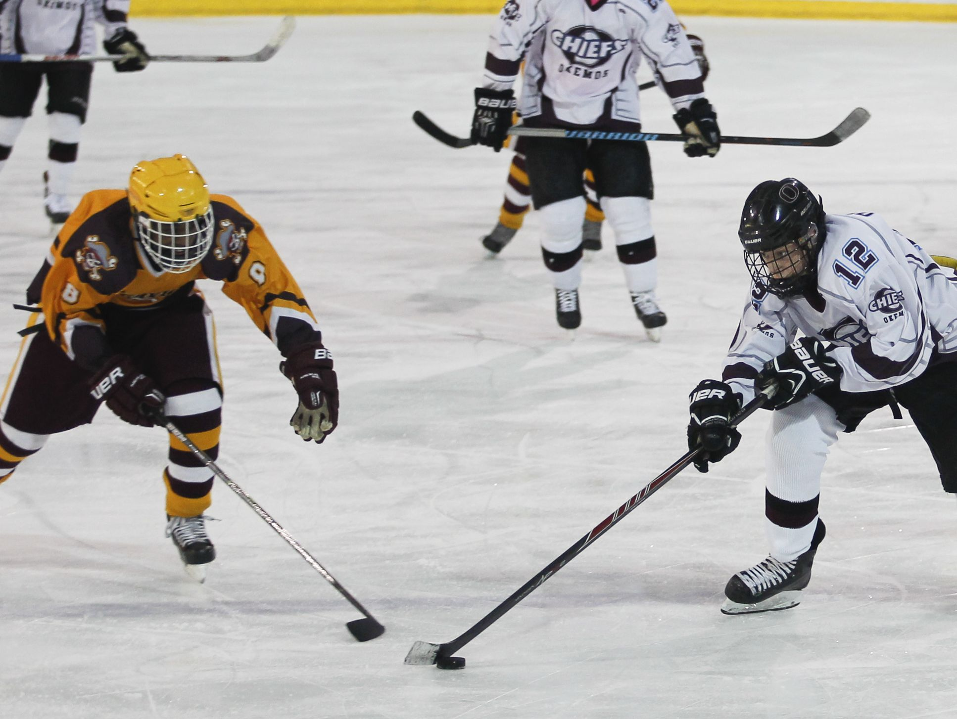Jack Desautel, right, and the Okemos hockey team are in the hunt for a third straight CAAC title.