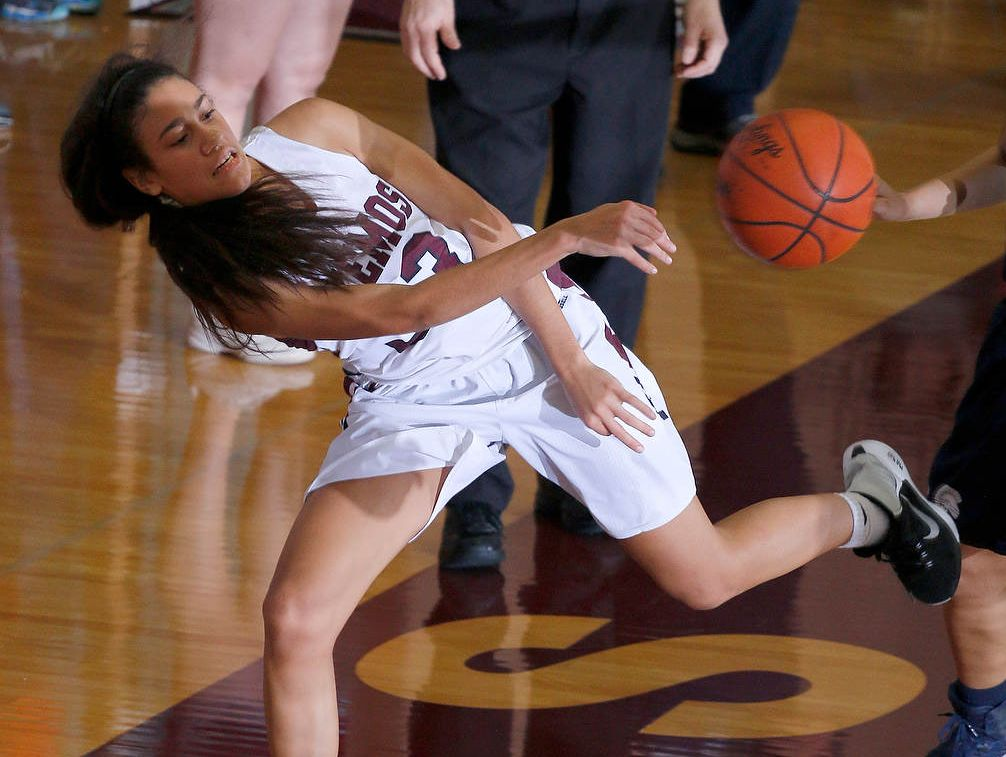 Okemos' Laya Hartman makes a leaping save against East Lansing Friday, Jan. 20, 2017, in Okemos, Mich.