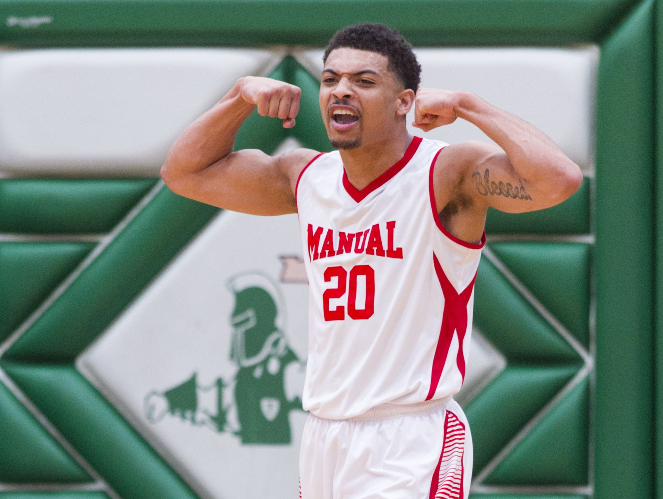 Indianapolis Emmerich Manual High School sophomore Thomas Waldon (20) reacts after a slam dunk during the first half of an IHSAA high school basketball game Saturday, Jan. 21, 2017, at Arsenal Tech High School. Four teams competed in the semi-final round of the Indianapolis City Boys Basketball Tournament.